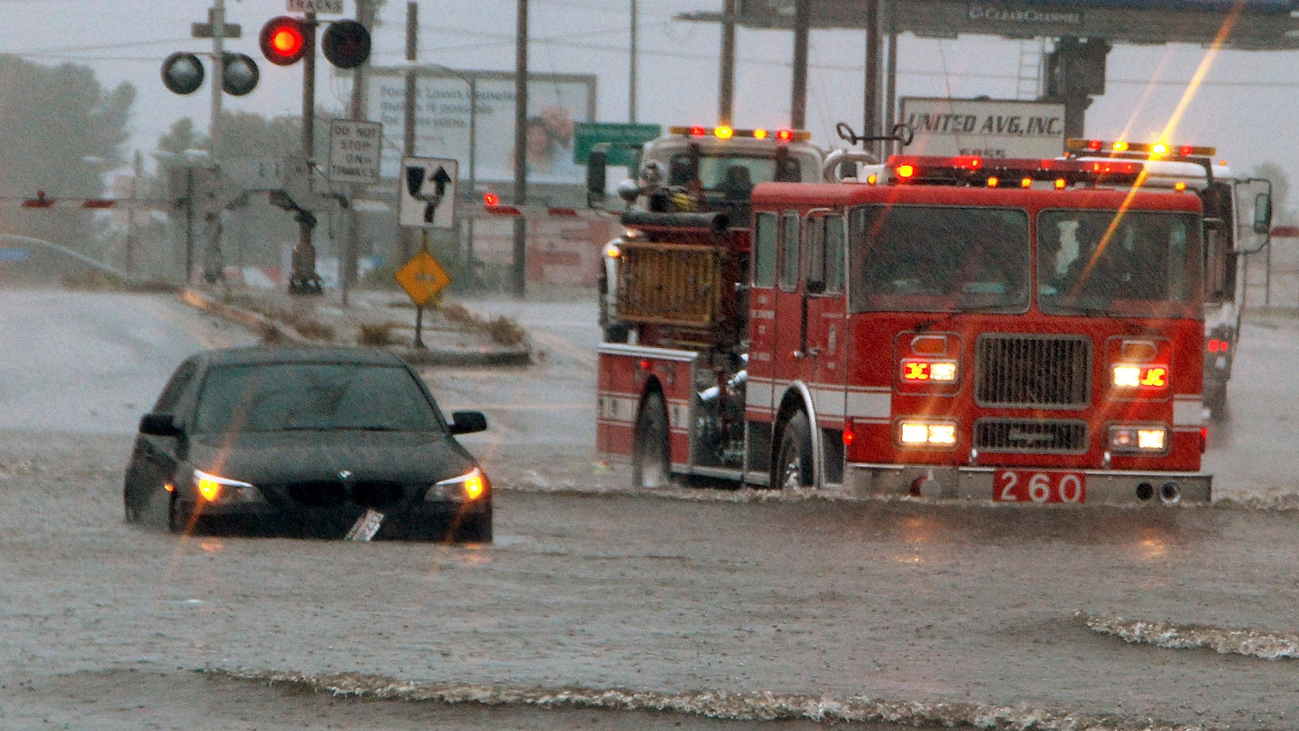 March 20: After confirming no one was trapped in this stalled car, a Los Angeles Fire Department engine company moves on to other flooded cars on Vineland Avenue in the North Hollywood area of Los Angeles' San Fernando Valley. The first day of spring arrived with a bang in Southern California on Sunday, bringing heavy snow to the mountains and illuminating the sky with flashes of lightning from Santa Barbara to downtown Los Angeles.