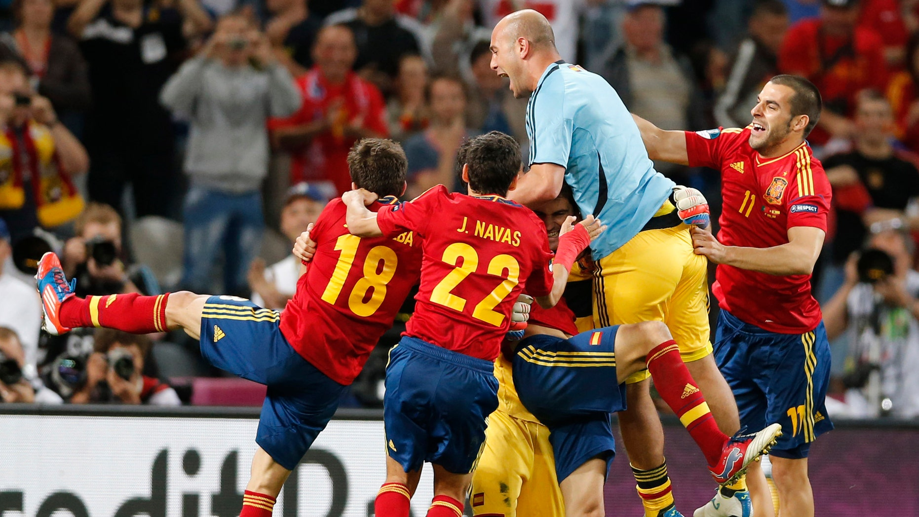 Spanish players celebrate winning the penalty shootout during the Euro 2012 soccer championship semifinal match between Spain and Portugal in Donetsk, Ukraine, Wednesday, June 27, 2012. (AP Photo/Antonio Calanni)