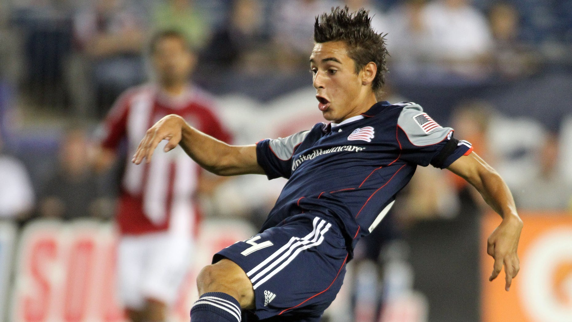 FILE - In this Aug. 6, 2011 file photo, New England Revolution midfielder Diego Fagundez scores a goal against Chivas USA during the second half of an MLS soccer match, in Foxborough, Mass. (AP Photo/Stew Milne, File)