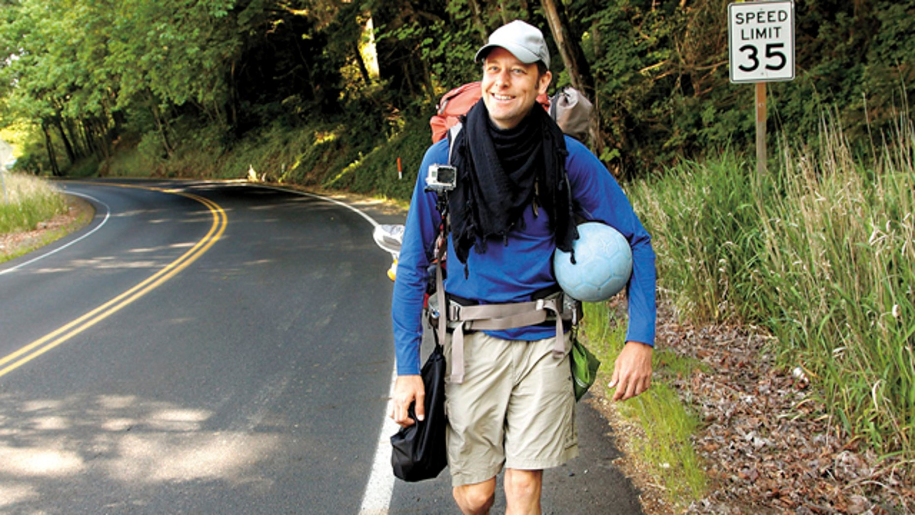May 7, 2013: Richard Swanson, of Seattle, walks along a road in Kelso, Wash.
