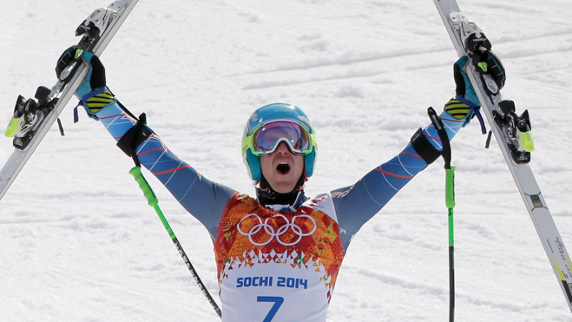 Feb. 19, 2014: United States' Ted Ligety celebrates after winning the gold medal in the men's giant slalom at the Sochi 2014 Winter Olympics in Krasnaya Polyana, Russia.