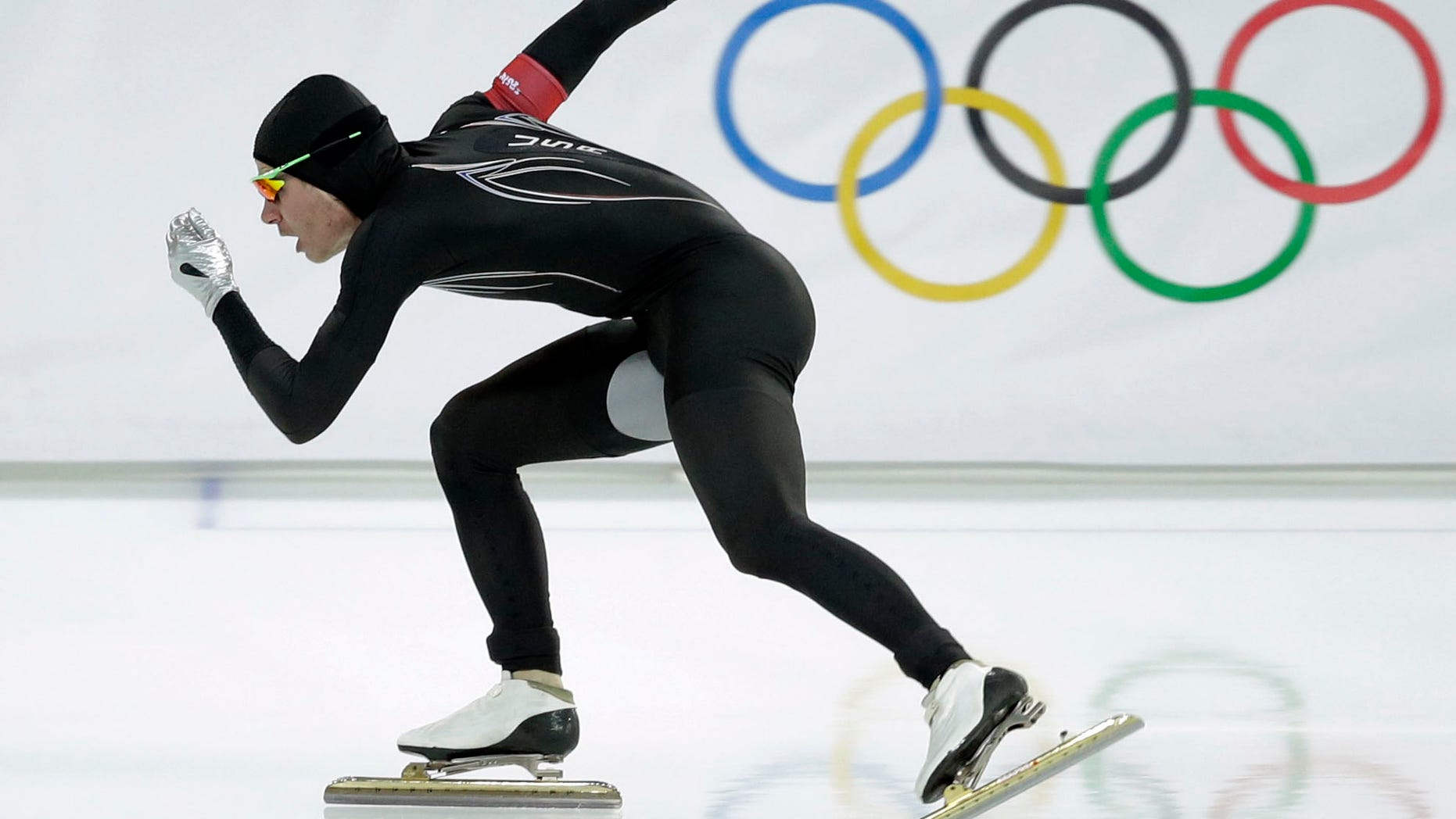 In this Monday, Feb. 10, 2014 file photo, Tucker Fredricks of the United States competes in the first heat of the men's 500-meter speedskating race at Adler Arena in Sochi, Russia, during the 2014 Winter Olympics. After a strong season on the World Cup circuit, the U.S. speedskating team has had a miserable performance the first week of the Sochi Olympics â and much of the speculation has turned to its new high-tech Under Armour skinsuit developed with help from aerospace and defense giant Lockheed Martin. (AP)