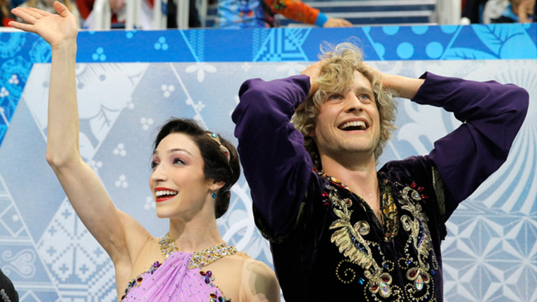Feb. 17, 2014: Meryl Davis and Charlie White of the United States react in the results area after competing in the ice dance free dance figure skating finals at the Iceberg Skating Palace during the 2014 Winter Olympics in Sochi, Russia.