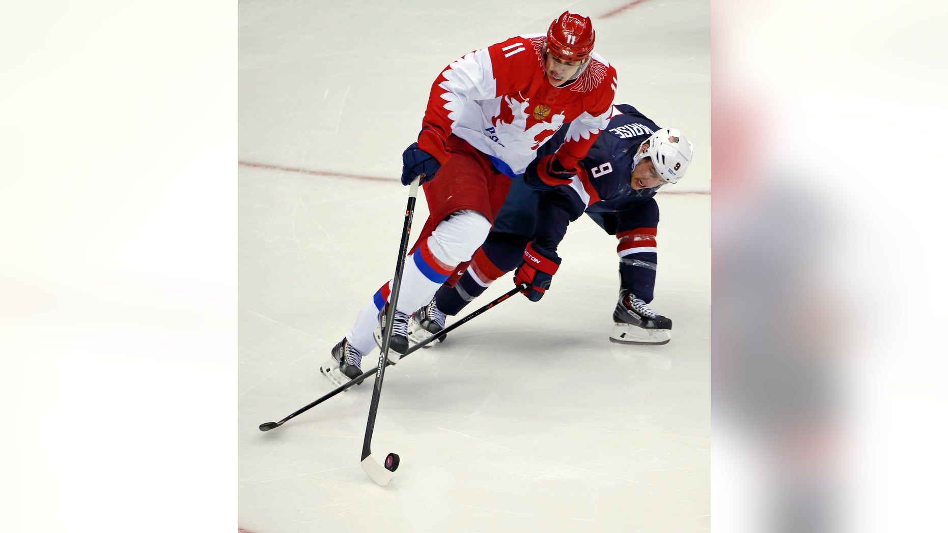Feb. 15, 2014: Russia forward Yevgeni Malkin and USA forward Zach Parise battle for the puck in the third period of a men's ice hockey game at the 2014 Winter Olympics in Sochi, Russia.