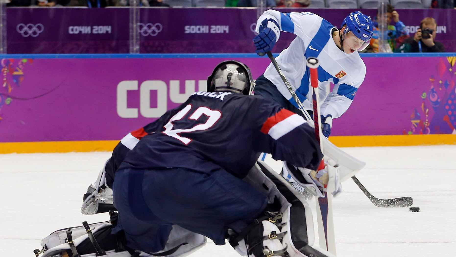 Feb. 22, 2014: Finland defenseman Olli Maatta shoots to score against USA goaltender Jonathan Quick during the third period of the men's bronze medal ice hockey game at the 2014 Winter Olympics in Sochi, Russia.