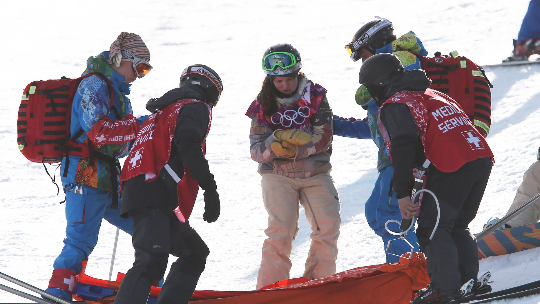 Feb. 12, 2014: United States' Arielle Gold is assisted after injuring her hand in a crash during the women's snowboard halfpipe qualifying at the Rosa Khutor Extreme Park, at the 2014 Winter Olympics in Krasnaya Polyana, Russia.