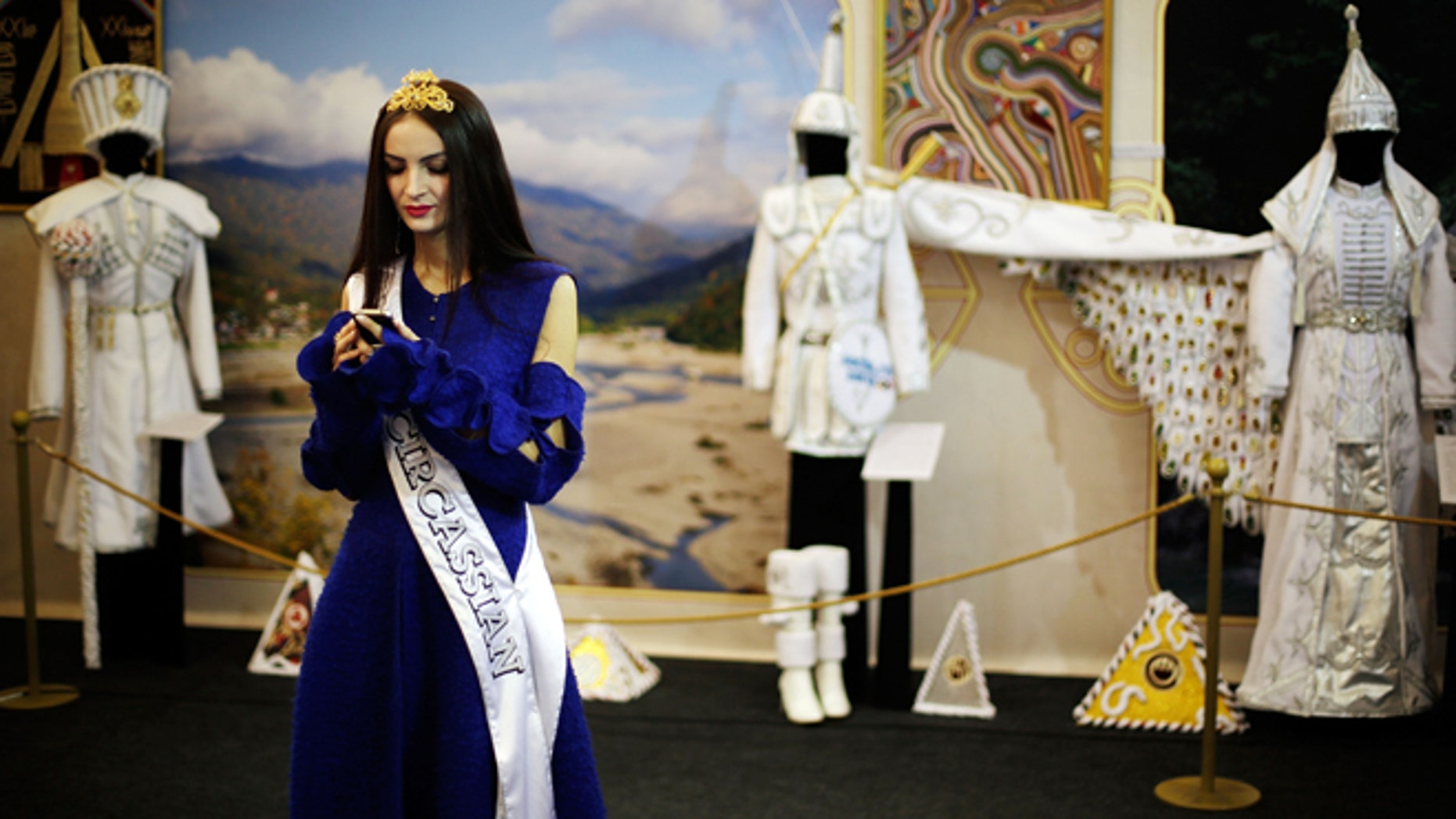 Feb. 14, 2014: In this photo, Bella Kukan, Miss Circassia from the town of Maikop, waits to greet visitors during a folk theatre troupe performance at the Circassian House in Olympic Park at the 2014 Winter Olympics in Sochi, Russia. The Circassians, an ethnic group indigenous to the land now hosting the Olympics, are using the games to call the worlds attention to their culture and history, which includes massacres by imperial Russian armies and persecution by Stalin.