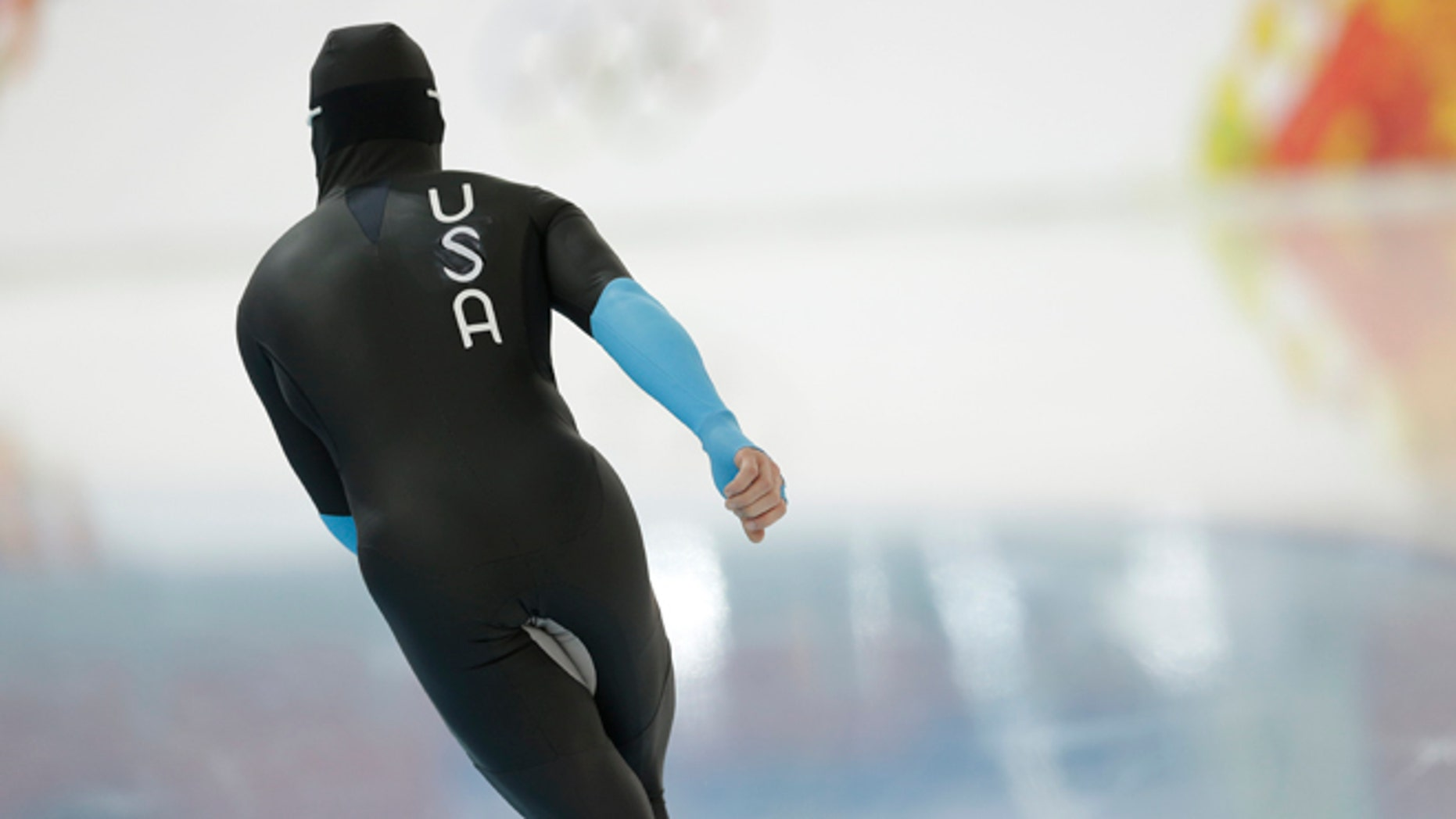 U.S. speedskater Joey Mantia warms-up wearing the old World Cup race suit, prior to the men's 1,500-meter race at the Adler Arena Skating Center during the 2014 Winter Olympics in Sochi, Russia, Saturday, Feb. 15, 2014. U.S. skaters are looking to bounce back from an awful start to their Olympics by slipping back into their old suits that should have been made obsolete by new high-tech gear. (AP Photo/Patrick Semansky)