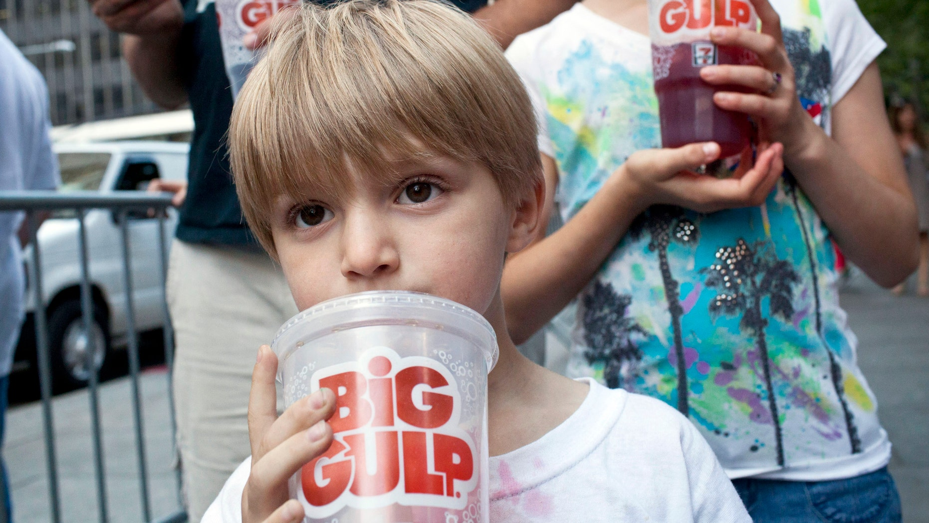 "Benjamin Lesczynski, 8, of New York, takes a sip of a ""Big Gulp"" while protesting the proposed ""soda-ban"" that New York City Mayor Michael R. Bloomberg suggested, outside City Hall in New York July 9, 2012."