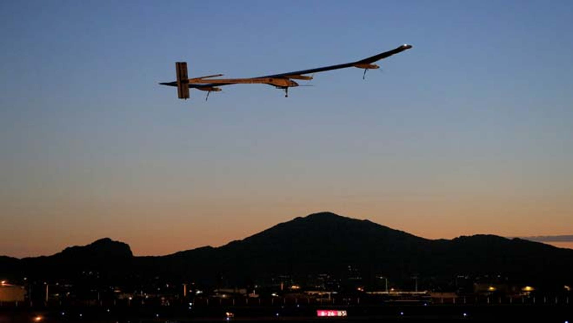 FILE - This May 22, 2013 file photo shows the Solar Impulse, piloted by André Borschberg, taking flight, at dawn, from Sky Harbor International Airport in Phoenix. The spindly no-fuel plane called Solar Impulse is scheduled to leave Washington Saturday early in the morning and arrive after midnight at New York's John F. Kennedy International Airport. It may silently buzz the Statue of Liberty on the way. The plane started its cross-country journey May 3 from San Francisco.
