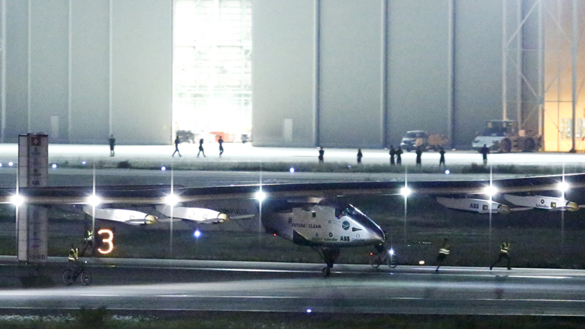 The Solar Impulse 2, a solar powered plane, touches down at Nagoya airport in Japan June 1, 2015.
