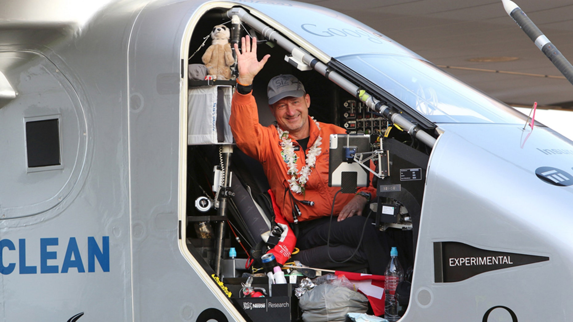 File photo - Pilot Andre Borschberg waves to the crowd after he landed Solar Impulse 2 at Kalaeloa airport, Hawaii, July 3, 2015.