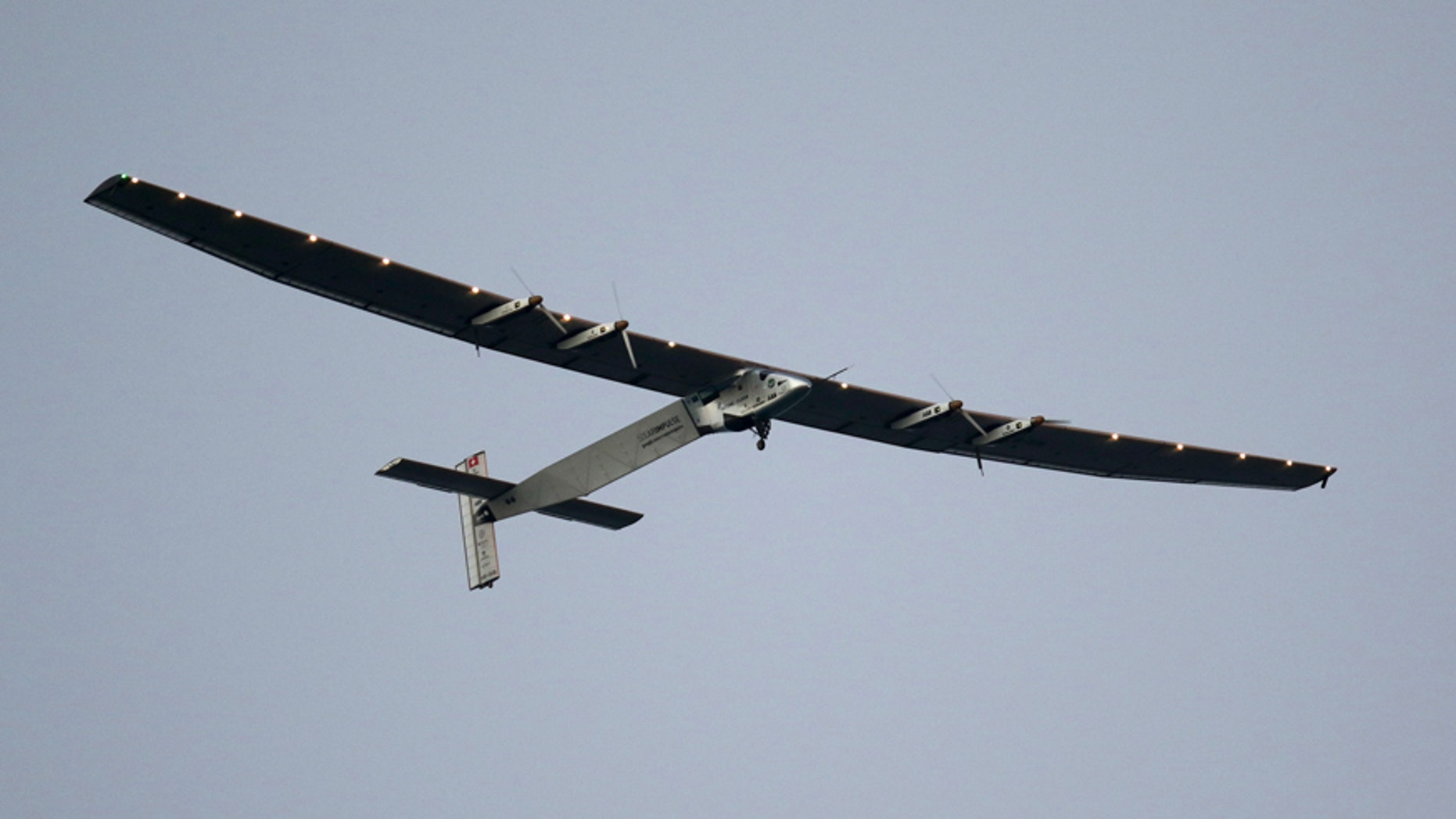 File photo - The Solar Impulse 2 airplane, piloted by Andre Borschberg, prepares to land at Kalaeloa airport after flying non-stop from Nagoya, Japan in Kapolei, Hawaii, July 3, 2015.