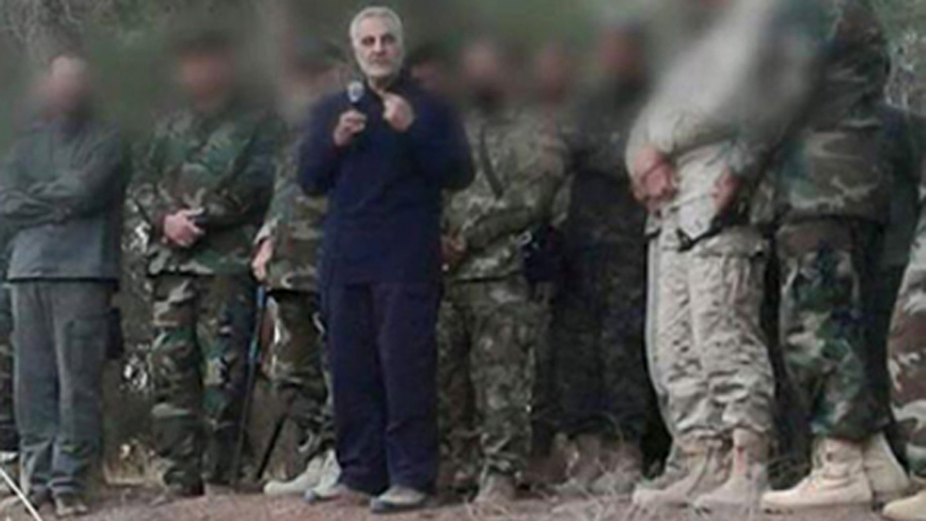 Maj. Gen. Qassem Soleimani, seen in blue suit, is commander of Iran's Islamic Revolutionary Guards Quds Force.