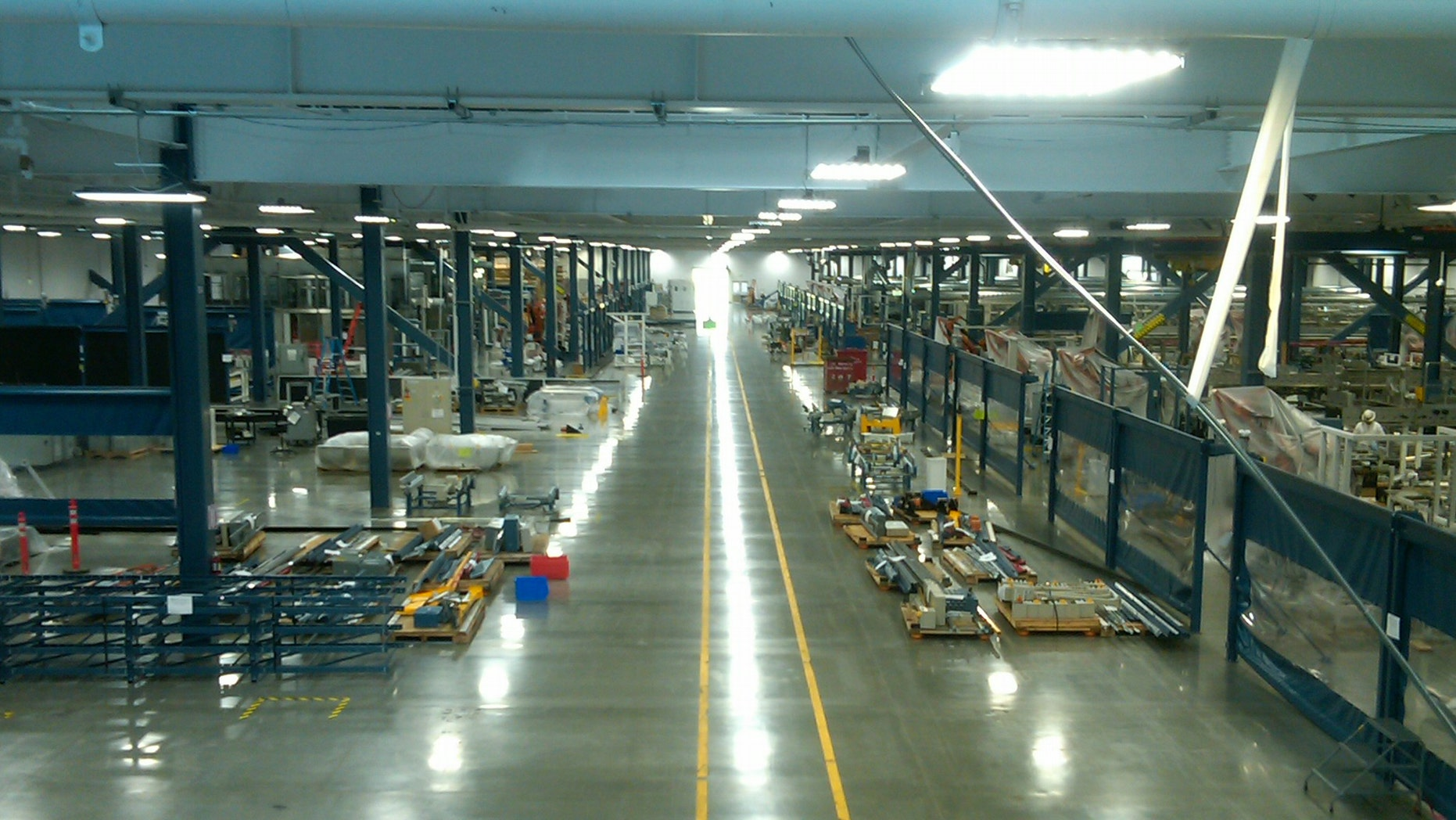 A view down the length of the massive Solyndra production floor, which will was auctioned off with the rest of the defunct company.