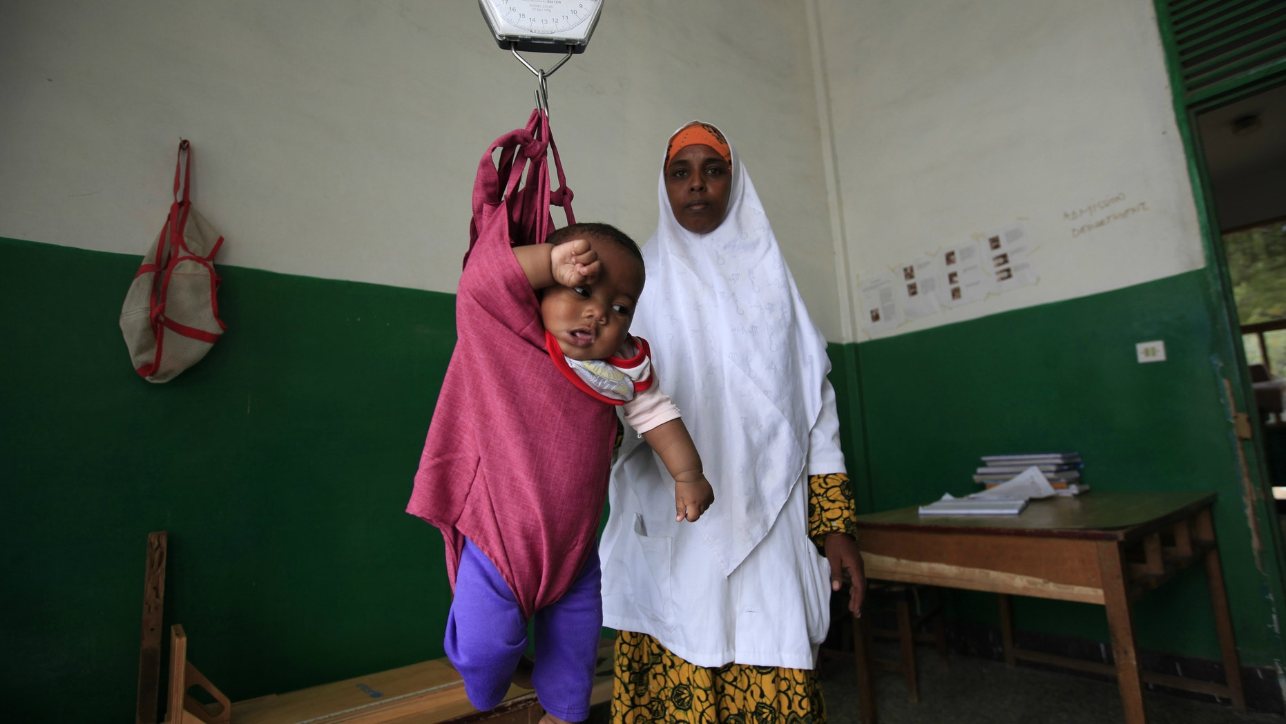 An internally displaced child is weighed at Banadir Hospital in Mogadishu, Somalia.