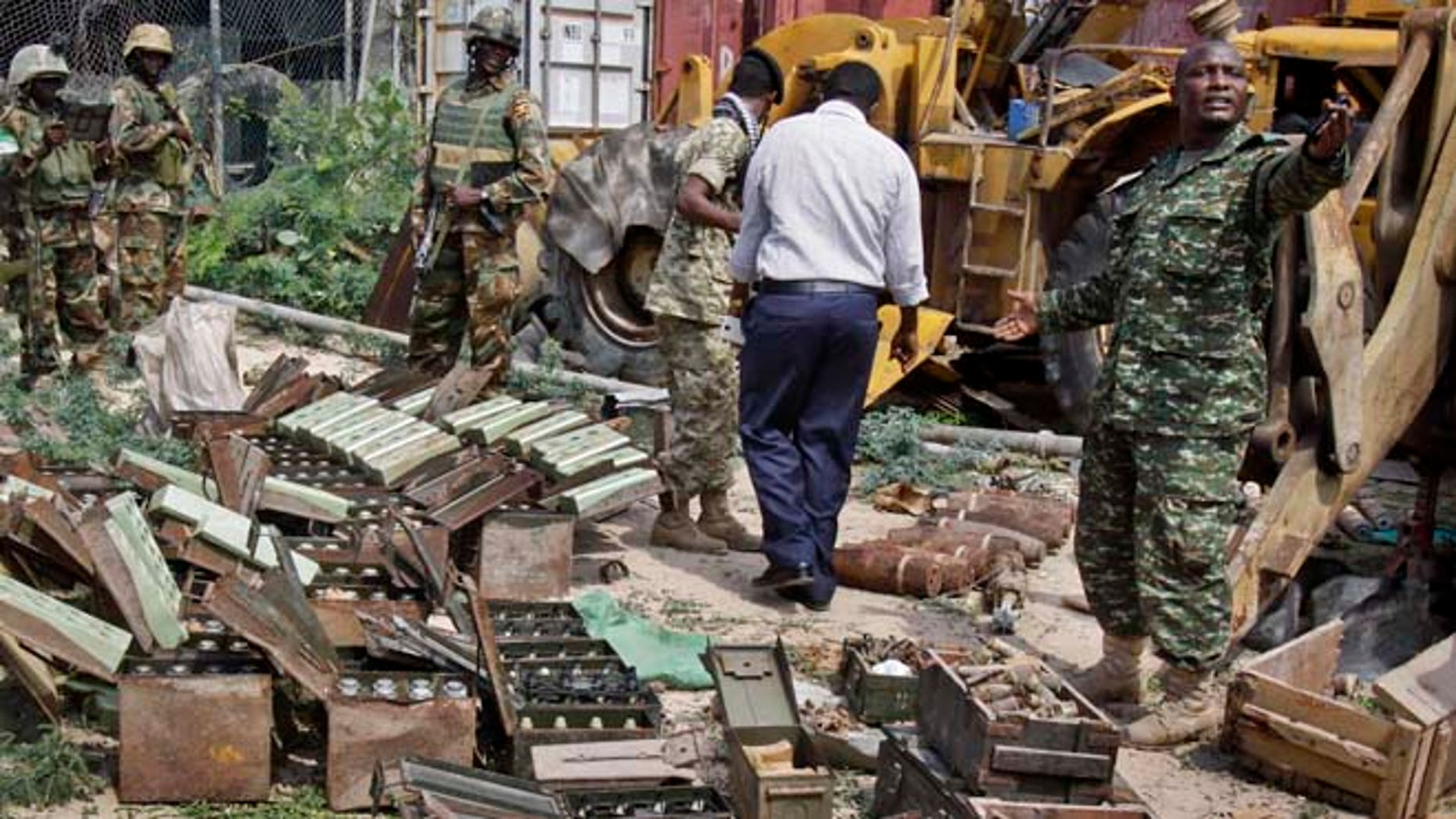 July 27, 2014: In this photo, African Union (AU) peacekeepers stand near a cache of weapons recovered from a garage in Mogadishu, Somalia. (AP)