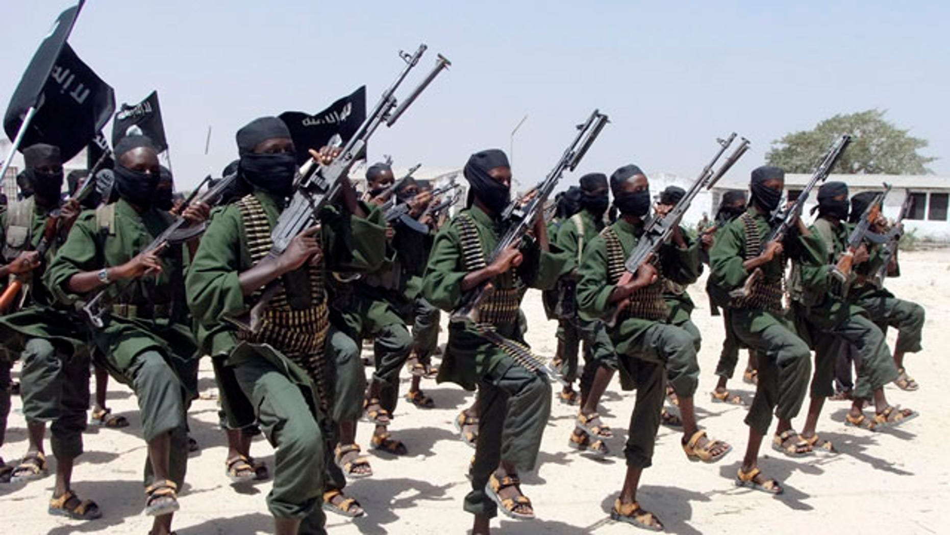 FILE - In this Thursday, Feb. 17, 2011 file photo, hundreds of newly trained al-Shabab fighters perform military exercises in the Lafofe area south of Mogadishu, in Somalia. (AP Photo/Farah Abdi Warsameh, File)