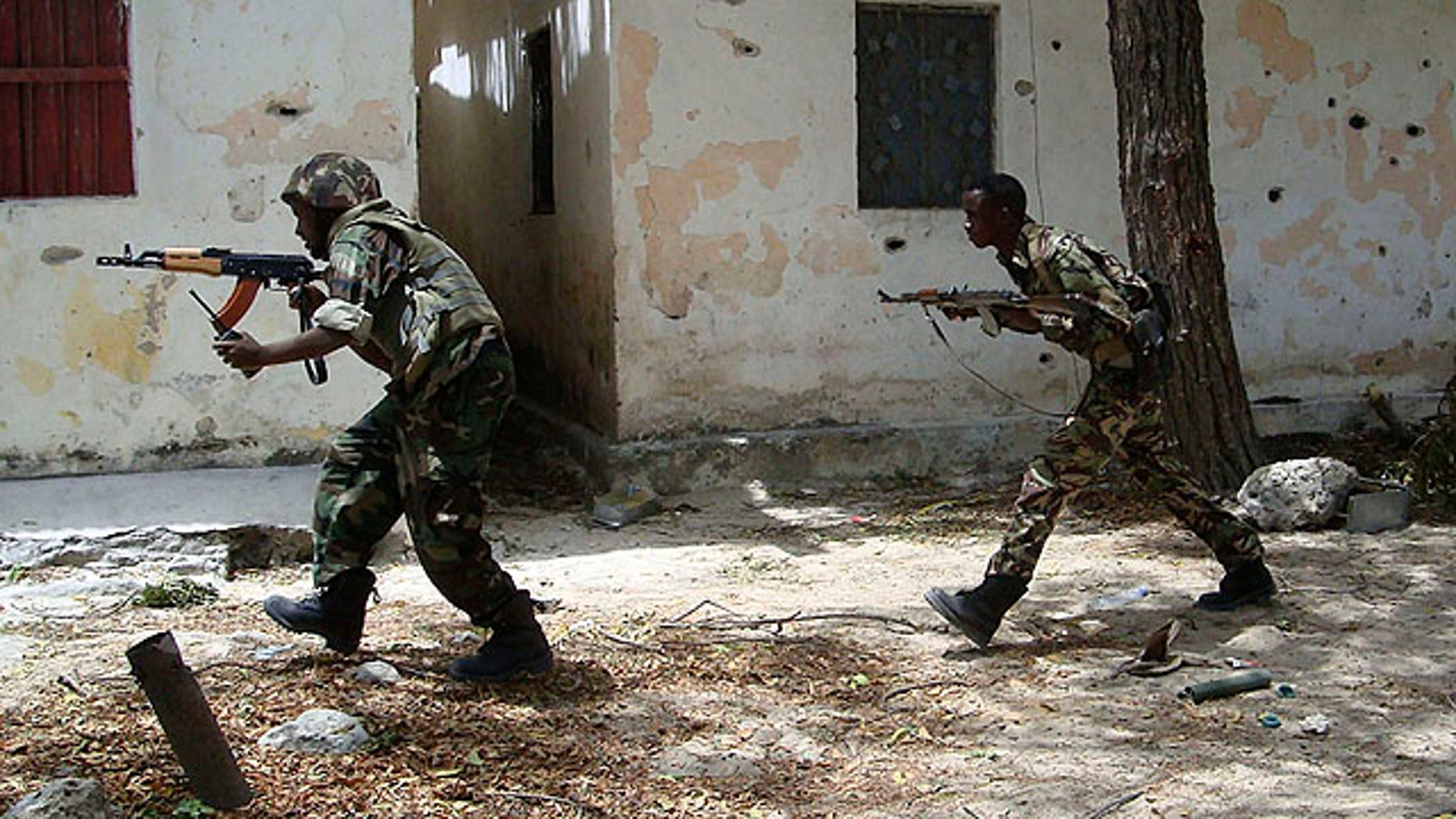 Sept. 27, 2010: Somali  government forces run in a street during skirmishes with insurgents from the al-Qaida aligned terrorist group Al-Shabaab in the Wardigley neighborhood in Mogadishu, Somalia.