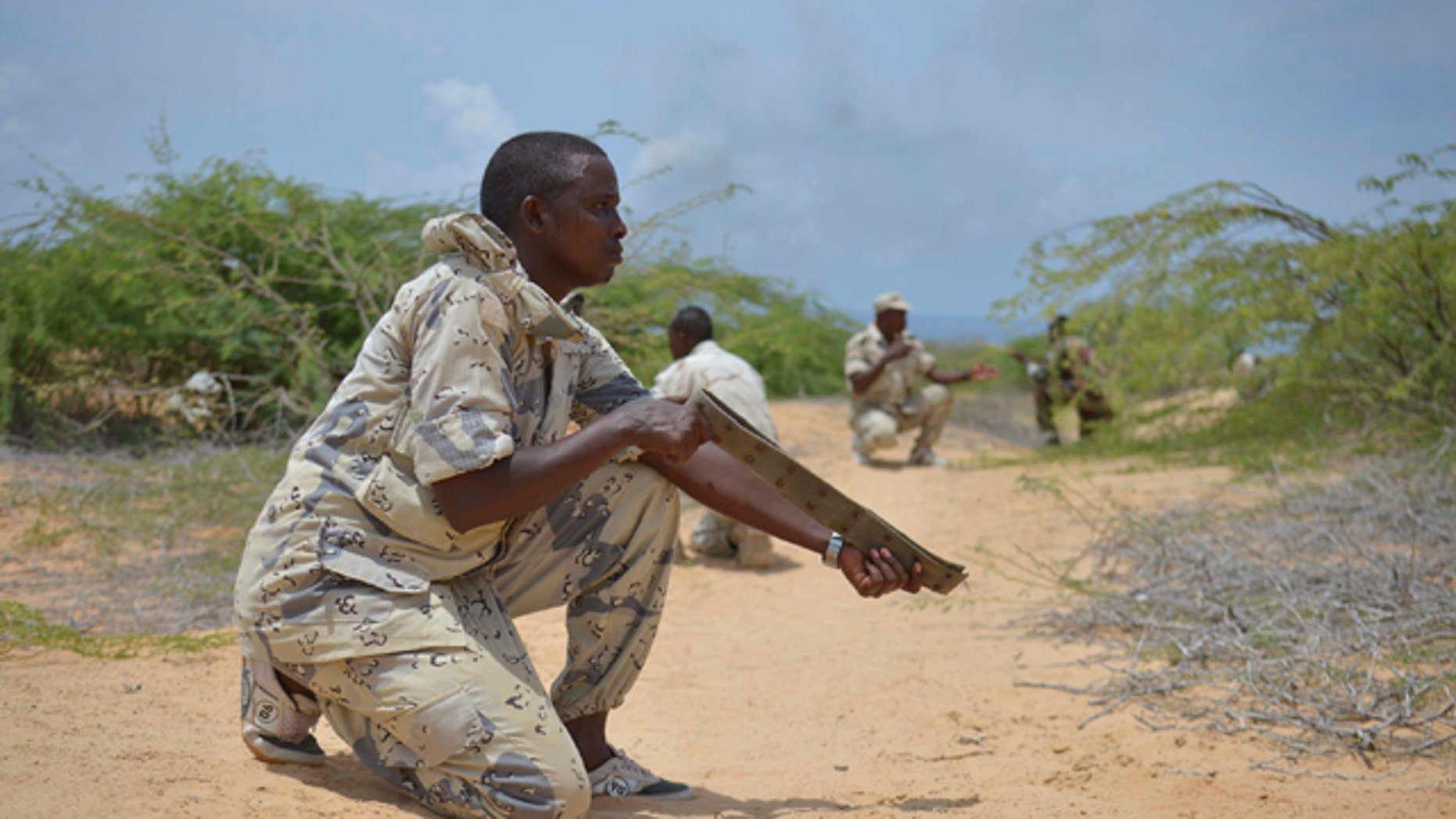 Mar. 29, 2013: A soldier from the Somali National Army (SNA) uses a belt acting as a weapon during a training exercise in Mogadishu.