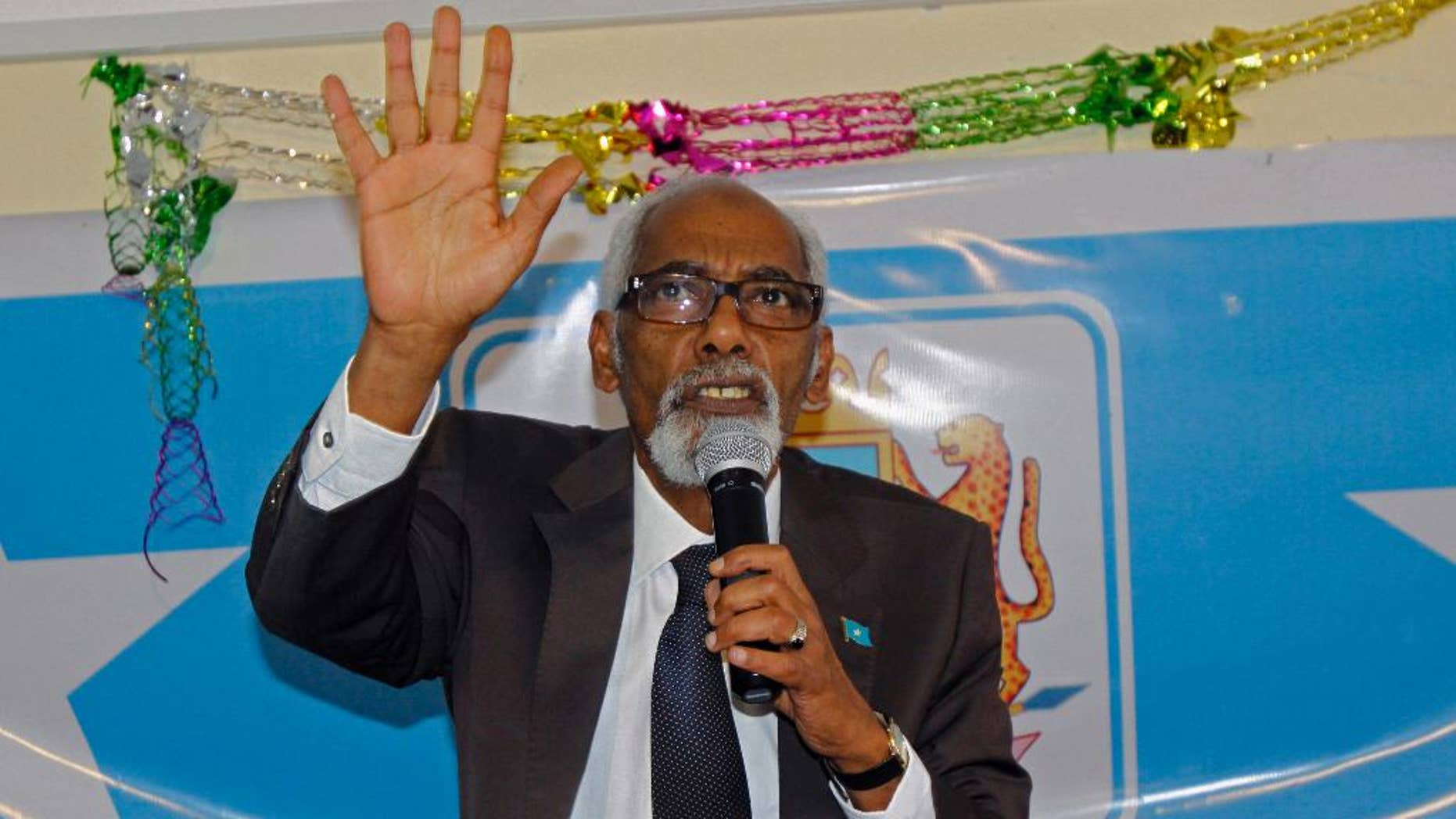 In this photo taken,Tuesday, Nov. 11, 2014,  Somalia's Speaker of Parliament Mohamed Sheikh Osman gestures, during a meeting at parliament hall in Mogadishu, Somalia. Somalia's parliamentary speaker says he has decided to drop an impeachment motion against the president in favor of talks to end the political crisis. (AP Photo/Farah Abdi Warsameh)