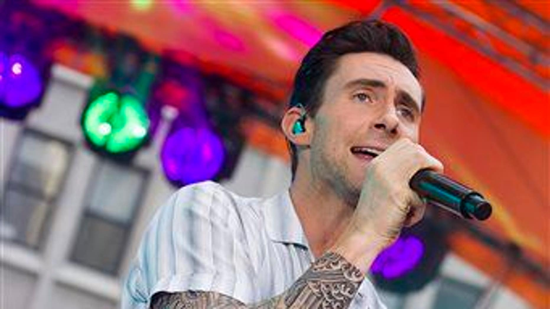 Adam Levine from Maroon 5 performs.