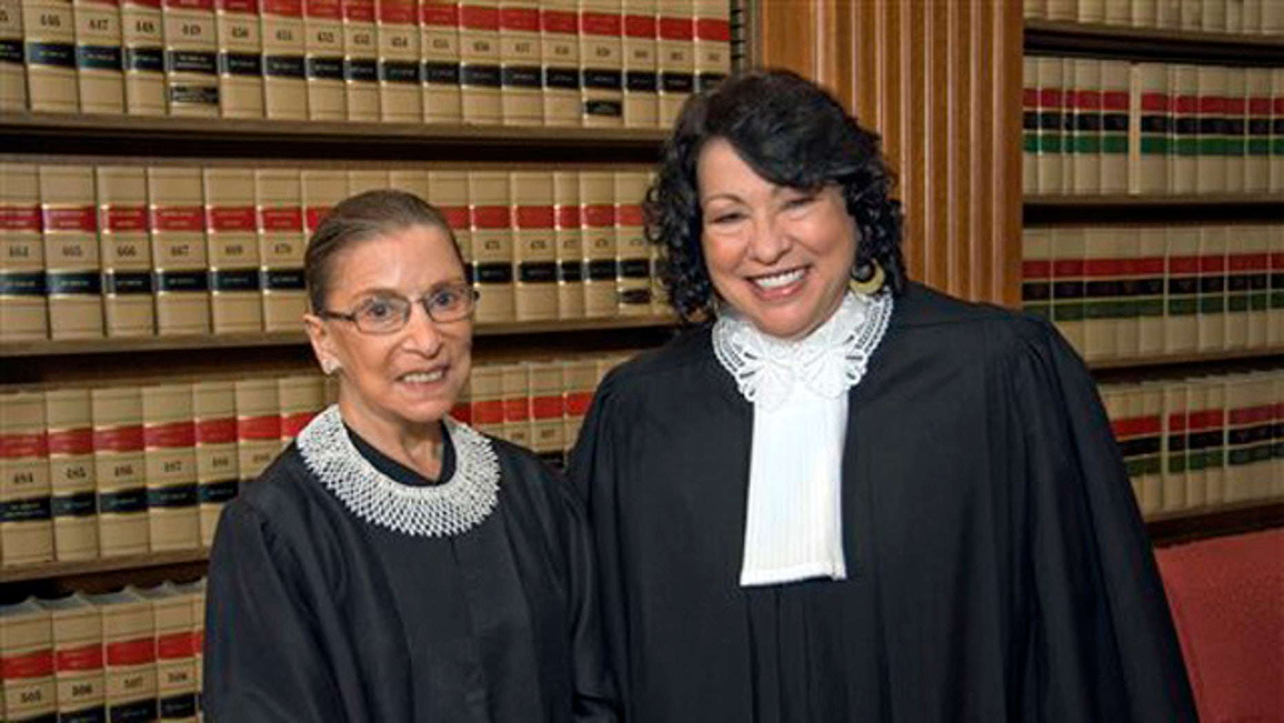 FILE - In this file photo, released Sept. 8, 2009 by the Supreme Court of the United States, Justice Ruth Bader Ginsburg, left, and Justice Sonia Sotomayor pose for a photo in the Justices' Conference Room at the court in Washington.  First Amendment cases top the Supreme Court's docket as it begins a new term with a new justice and three women on the bench for the first time.   (AP Photo/Collection of the Supreme Court of the United States, Steve Petteway, File)