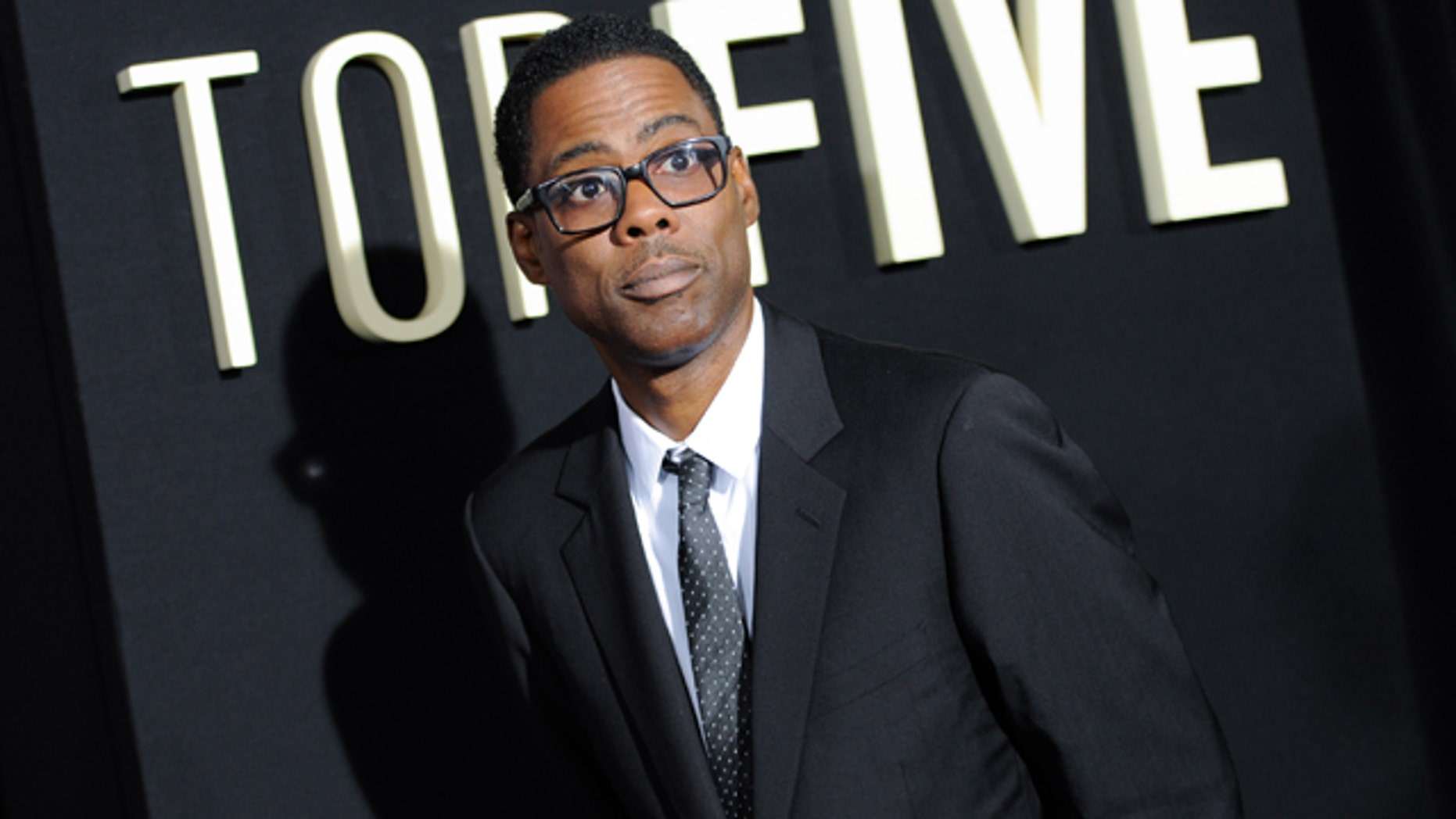 FILE - In this Dec. 3, 2014 file photo, actor Chris Rock attends the premiere of 'Top Five' at the Ziegfeld Theatre in New York. (Photo by Evan Agostini/Invision/AP, File)
