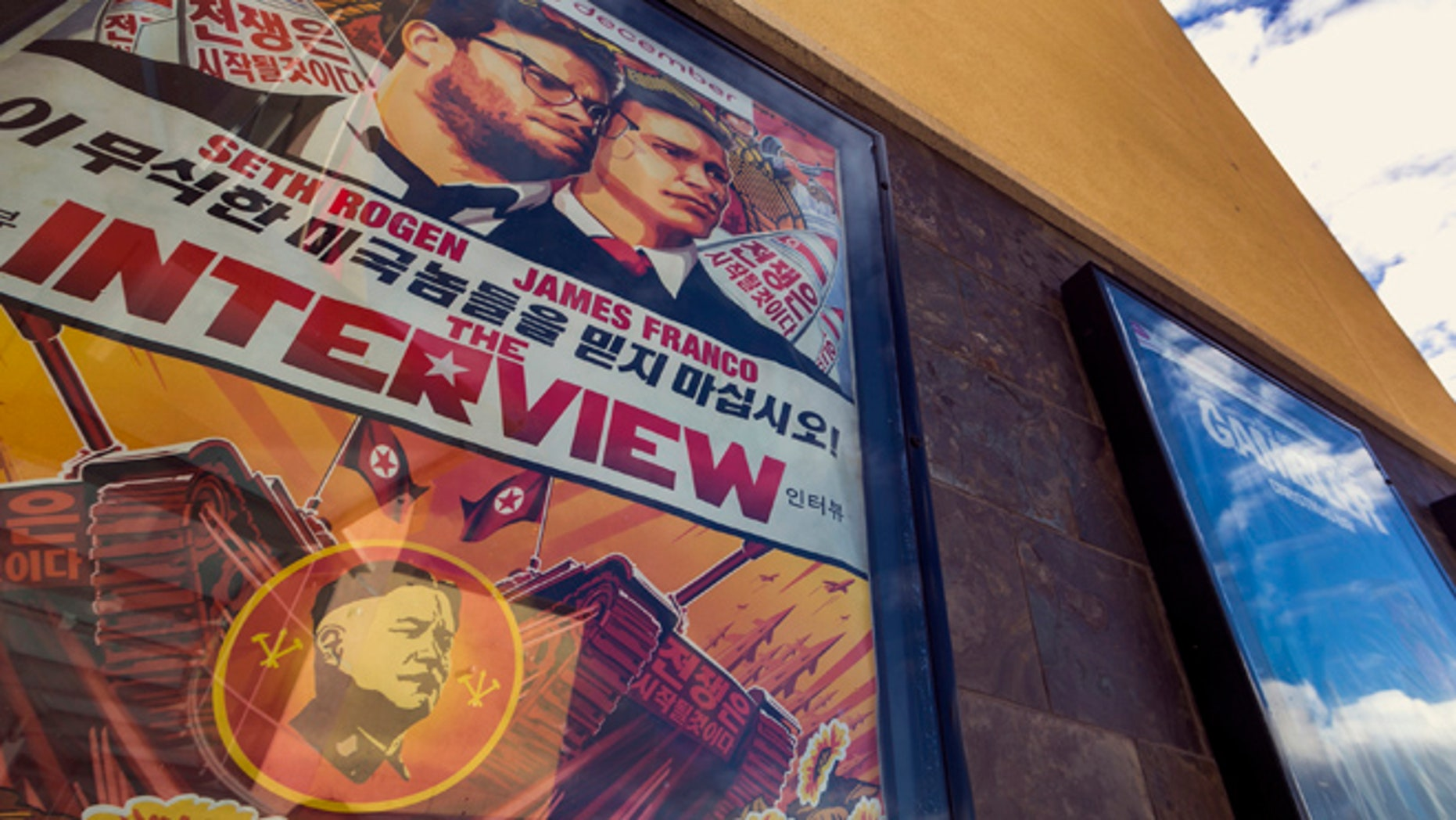 """Dec. 17, 2014: This photo shows a movie poster for the movie """"The Interview"""" on display outside the AMC Glendora 12 movie theater, in Glendora, Calif. (AP)"""