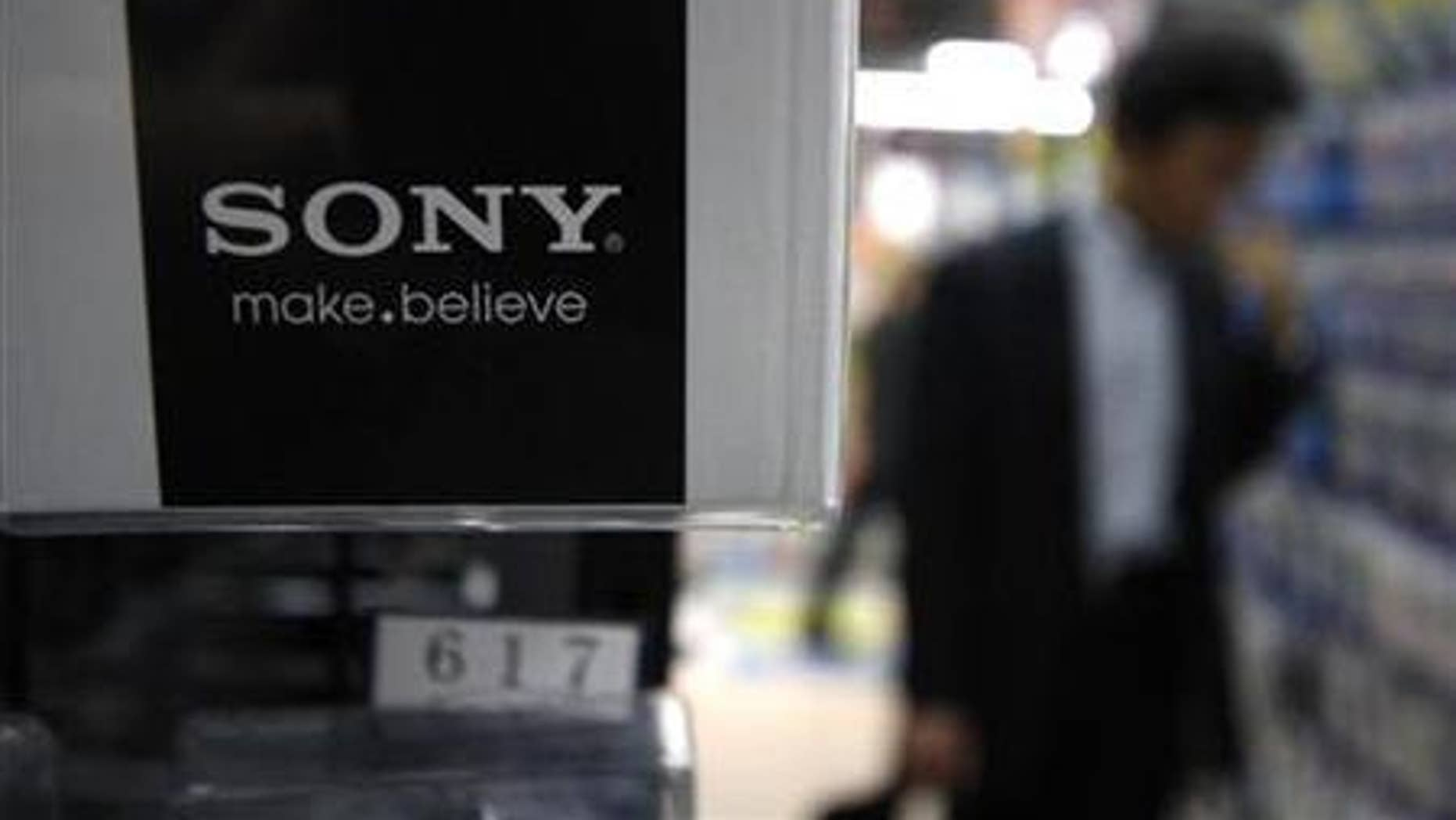 A man looks at Sony Corp's products at an electronics store in Tokyo May 26, 2011.