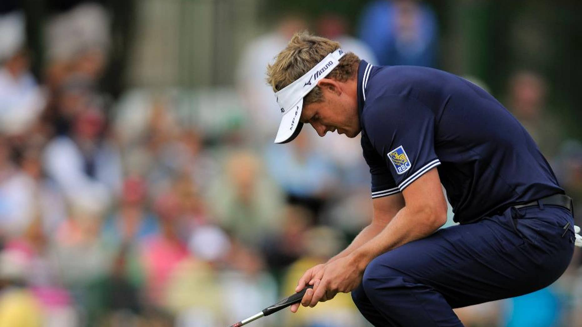 FILE - In this April 20, 2014, file photo, Luke Donald, of England, reacts after missing a birdie putt on the 17th green during the final round of the RBC Heritage golf tournament in Hilton Head Island, S.C. Some of the biggest stars in Europe are starting their year in Abu Dhabi on Thursday. Donald is in Honolulu. That's by design. This year is about getting back to his strengths, and getting back to his roots. Donald could pick off a few European Tour requirements, but he tends to play well during the West Coast Swing on the PGA Tour, and that's where he will start. And thus begins what he hopes will be the road back at the Sony Open. (AP Photo/Stephen B. Morton, File)