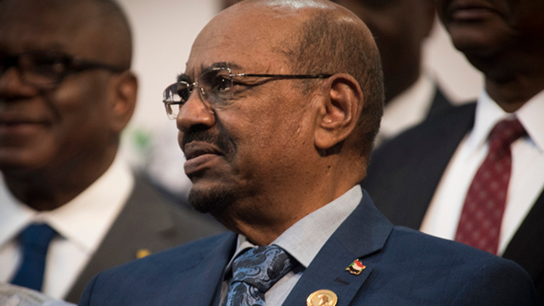 June 14, 2015: Sudanese president Omar al-Bashir is seen during a photo op at the African Union summit in Johannesburg. A South African judge on Sunday ordered authorities to prevent al-Bashir from leaving the country because of an international order for his arrest, human rights activists said.(AP Photo/Shiraaz Mohamed)