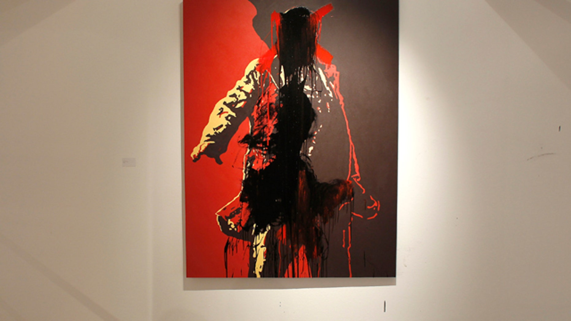 May 22, 2011: An unidentified man defaces a controversial portrait of South African President Jacob Zuma at the Goodman Gallery in Johannesburg, South Africa.