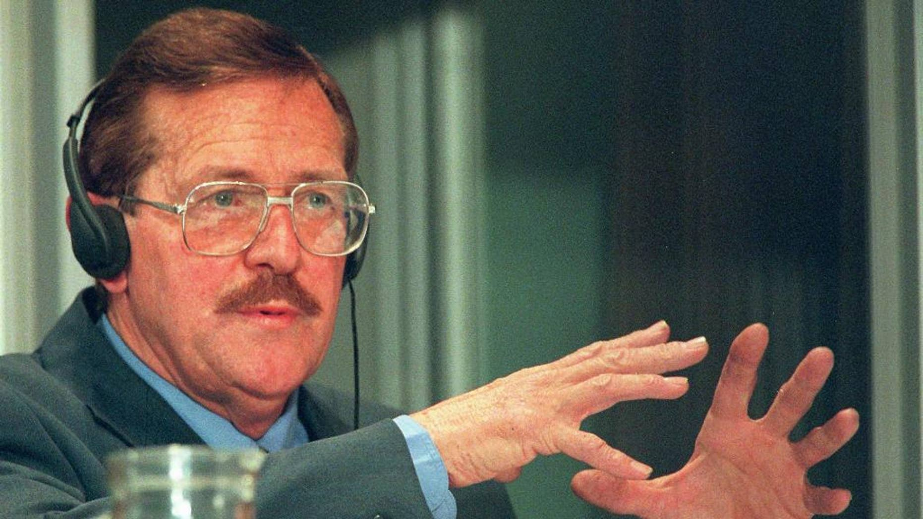 FILE - In this Tuesday Aug. 19, 1997 file photo, former Conservative Party politician Clive Derby-Lewis, makes a statement at an amnesty hearing in Pretoria, South Africa. On Friday, May 29, 2015 a judge granted parole to Derby-Lewis who was convicted for the 1993 assassination of Chris Hani, leader of the South African Communist Party and head of the African National Congress' military wing during apartheid, for which he received a life sentence. (AP Photo/Joao Silva-File)
