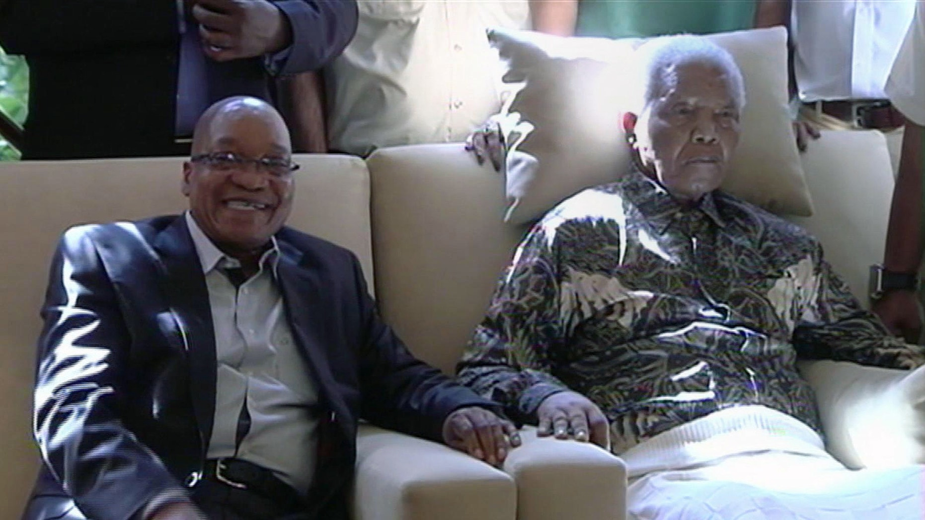 April 29, 2013 - In this image taken from video, South African President Jacob Zuma, left, sits with the ailing anti-apartheid icon Nelson Mandela.