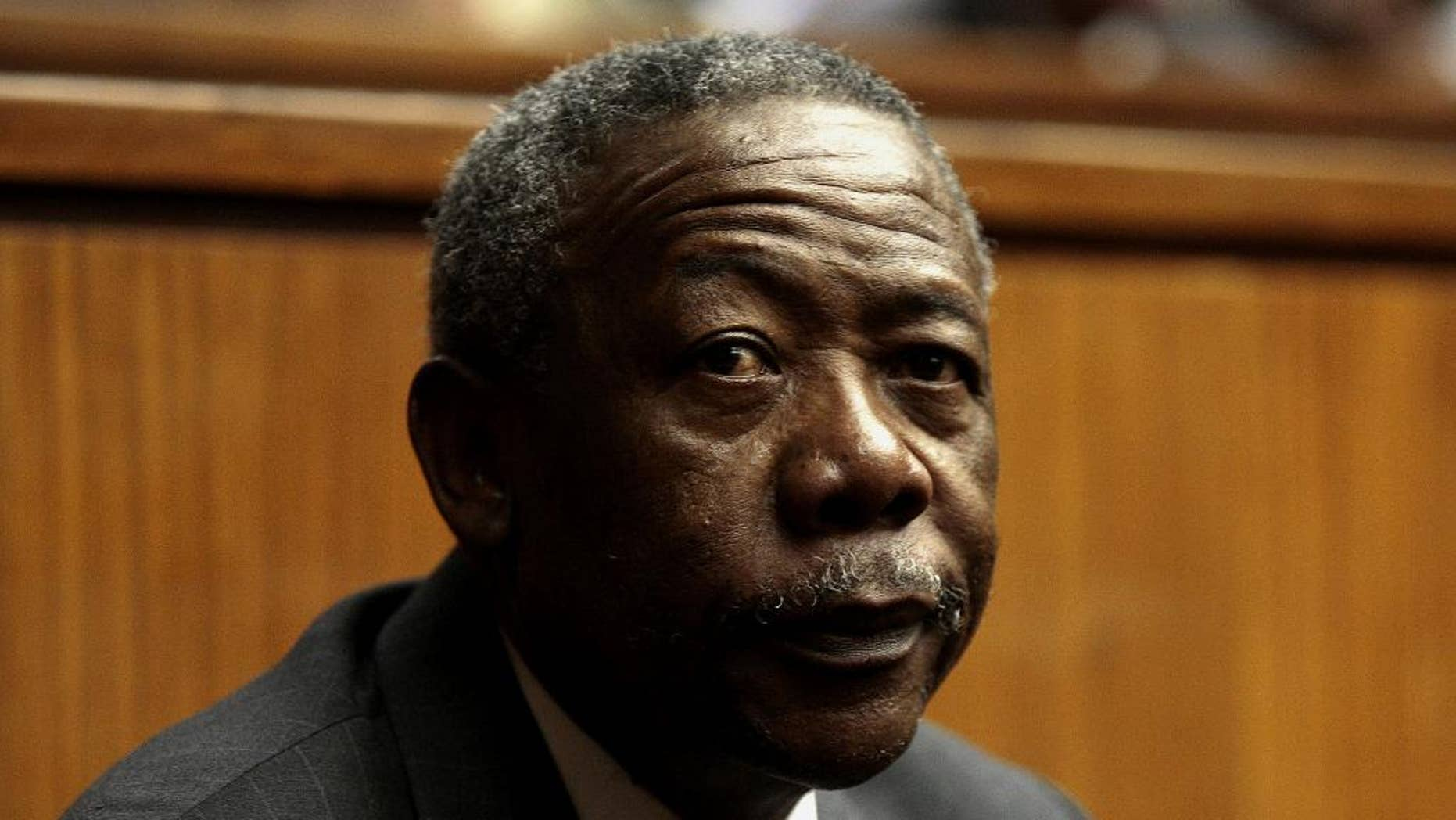 FILE - In this Tuesday, Aug. 3, 2010 file photo, South African former police commissioner Jackie Selebi attends his sentencing on corruption charges at the High Court in Johannesburg, South Africa. The family of South Africa's former national police chief, Jackie Selebi, who was disgraced after he was found guilty of corruption, said on Friday, Jan. 23, 2015 that he has died following a long illness. (AP Photo-File)