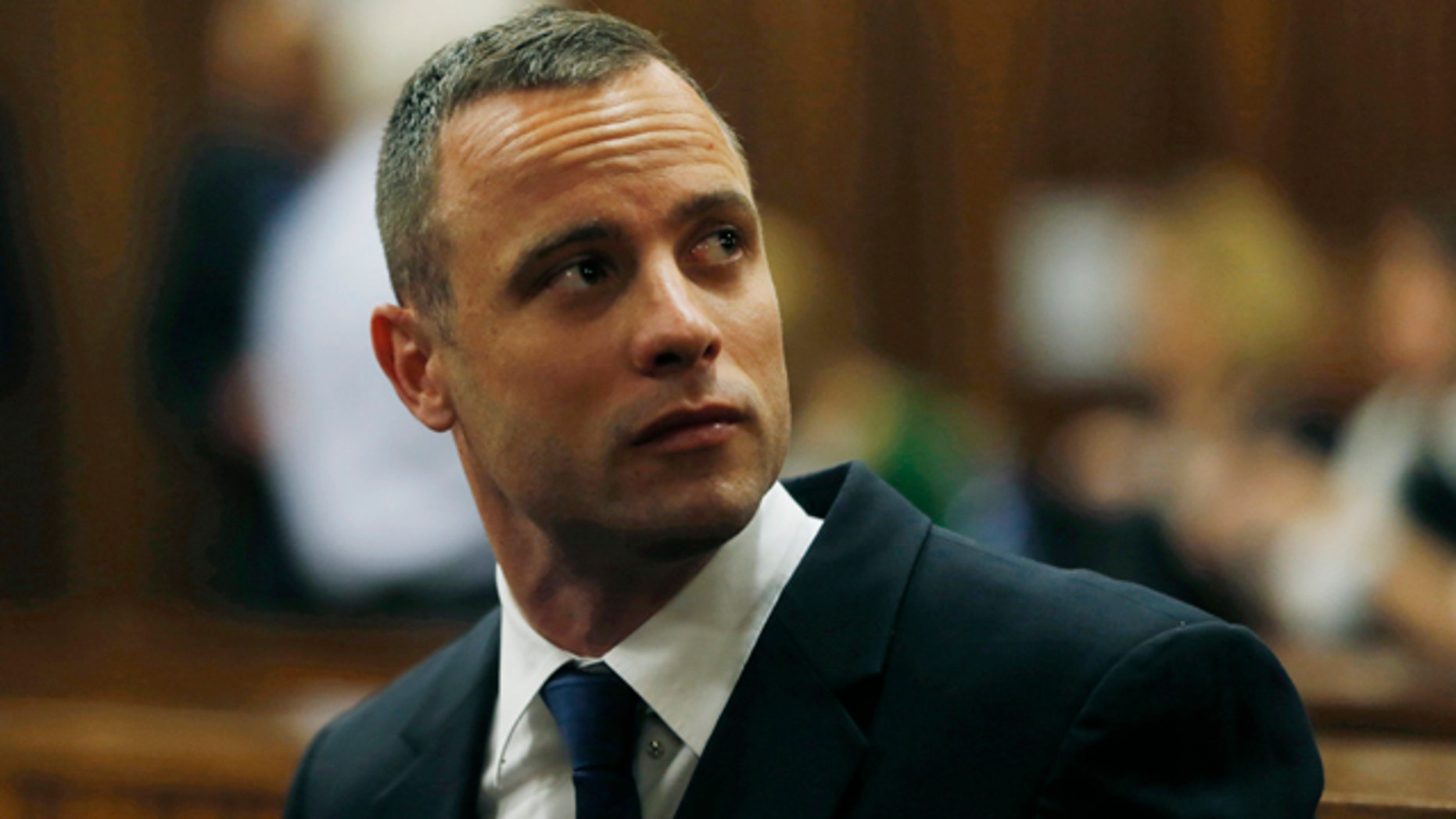 May 6, 2014: Oscar Pistorius is seated in a courtroom at the high court in Pretoria, South Africa. (AP Photo/Mike Hutchings, Pool)