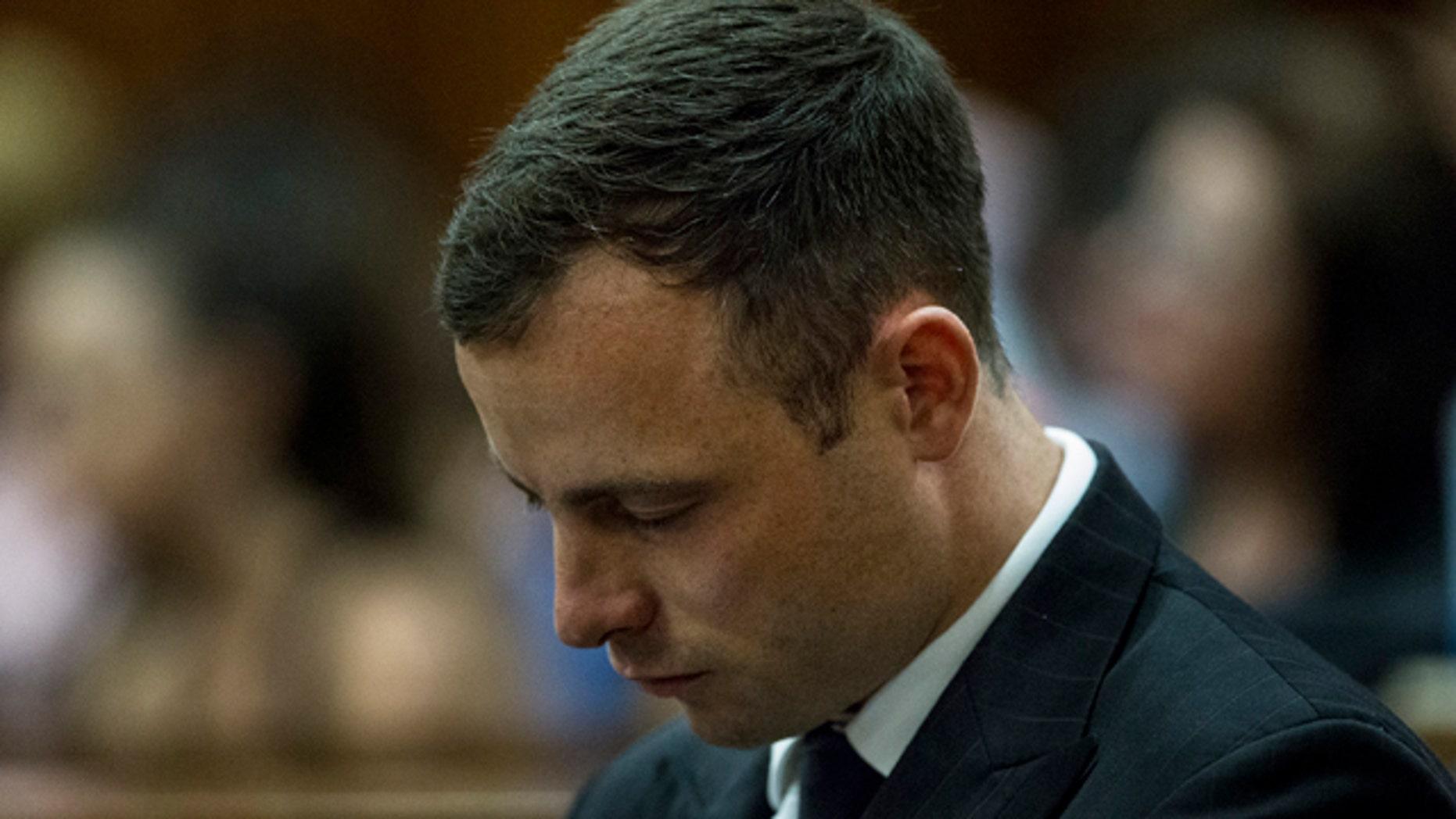 October 13, 2014: Oscar Pistorius arrives in court to face sentencing for the shooting death of his girlfriend Reeva Steenkamp. (AP Photo/Marco Longari. Pool)