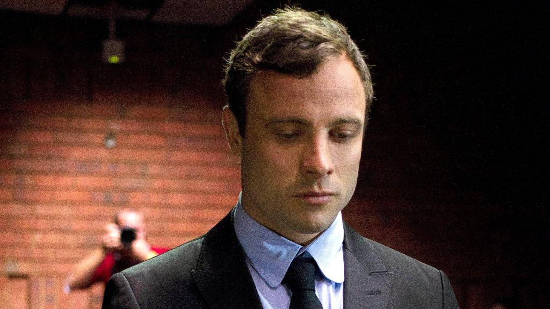 Aug. 19, 2013 - FILE photo of double-amputee Olympian Oscar Pistorius at the magistrates court to be indicted on charges of murder and illegal possession of ammunition for the shooting death of his girlfriend on Valentine's Day in Pretoria, South Africa.