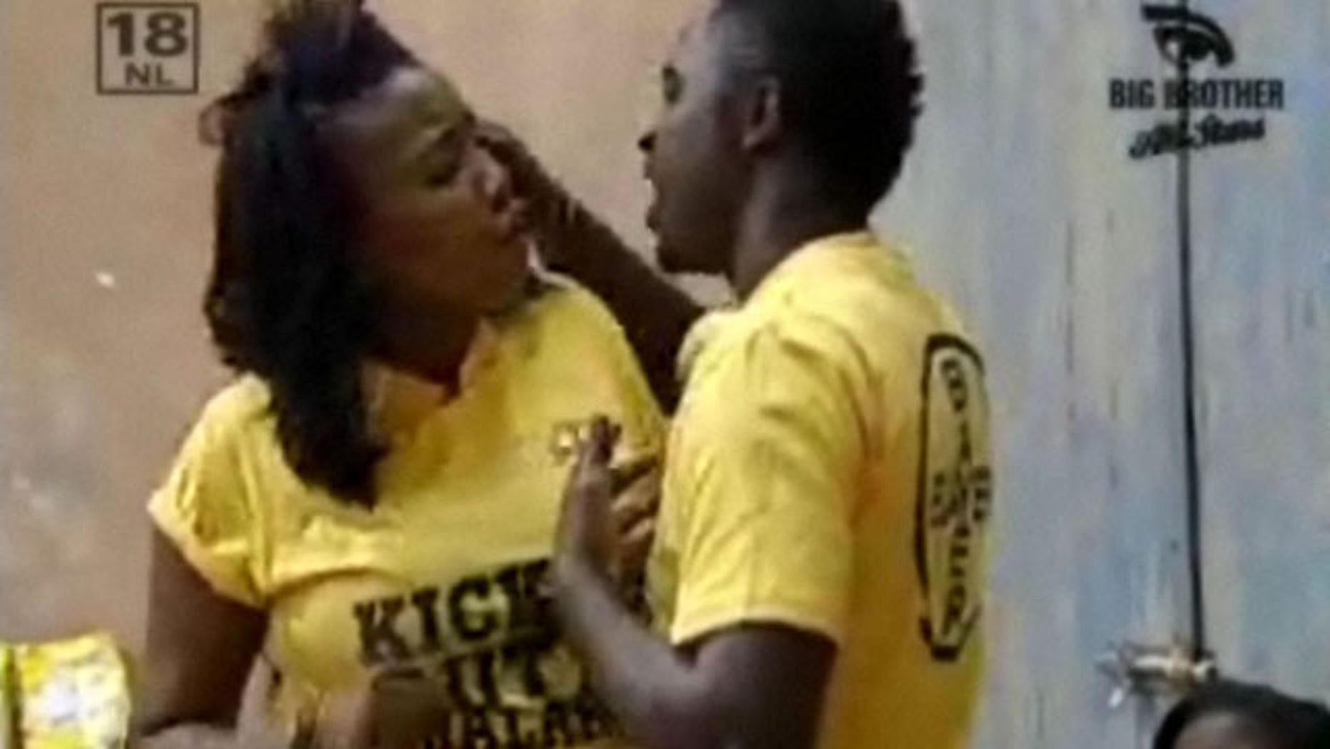 In this framegrab from the Big Brother reality show shows an altercation between Uganda's Hannington Kuteesa, and South Africa's Lerato Sengadi, this week. The South African pay channel says it will evict Kuteesa for assaulting female fellow star Sengadi on air. (AP)