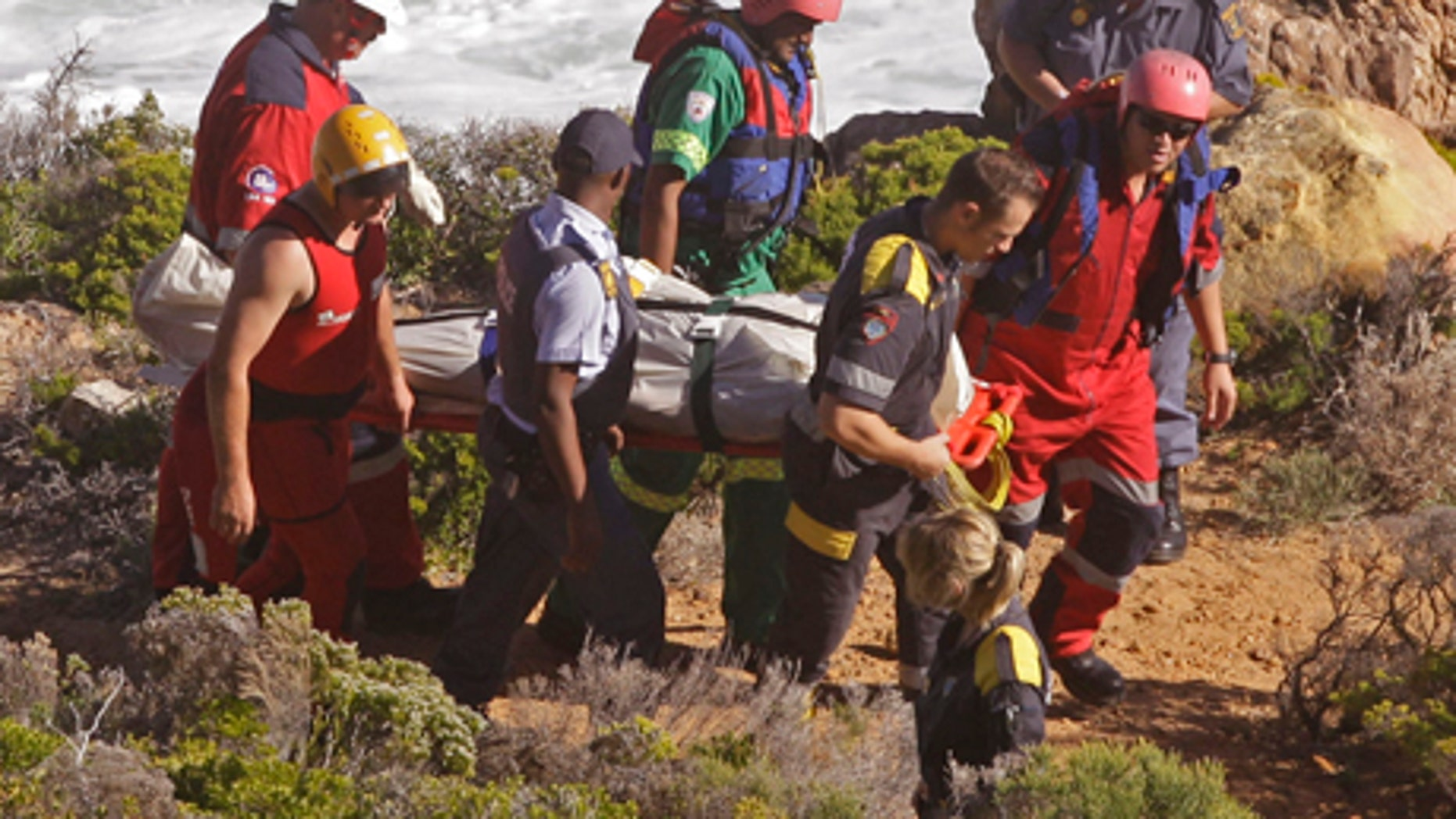 April 19, 2012: The body of a shark attack victim is carried by Police and Rescue personnel near the coastal town of Gordon's Bay, South Africa.