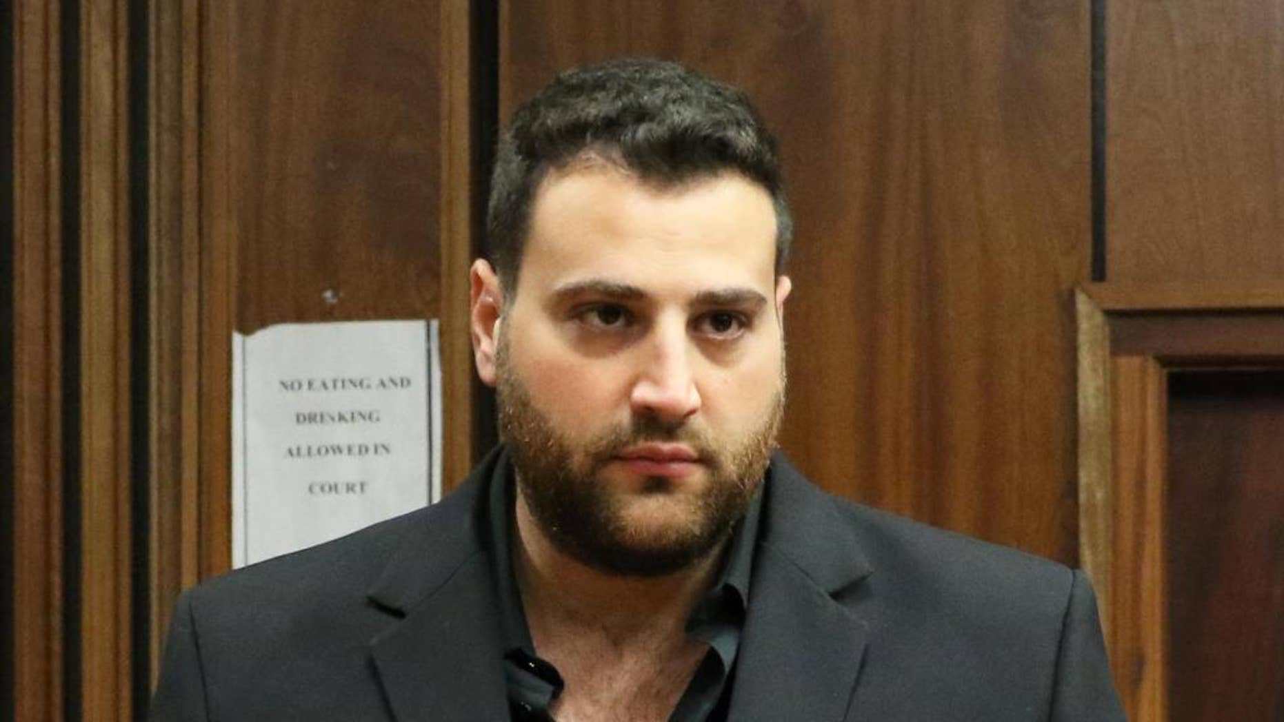 Christopher Panayiotou appears at a court to face a murder charge in Port Elizabeth, South Africa, Monday, May 4, 2015. Panayiotou has been charged with his wife's murder, days after local media reported that the heartfelt eulogy he delivered at her funeral was plagiarized, police said on Monday. (AP Photo/Judy de Vega)