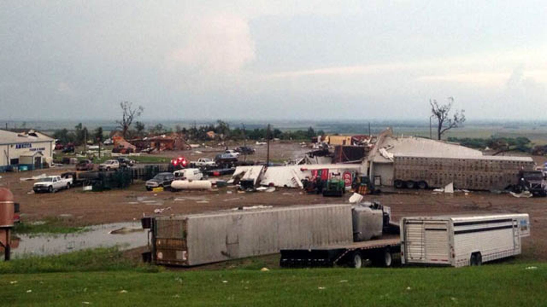 June 18, 2014: This photo provided by  KDLT shows damaged buildings in Wessington Springs, S.D. A tornado hit Wessington Springs Wednesday, damaging homes and businesses and injuring at least one person, according to the National Weather Service and a hospital spokeswoman. (AP Photo/KDLT, Brian Kirk)