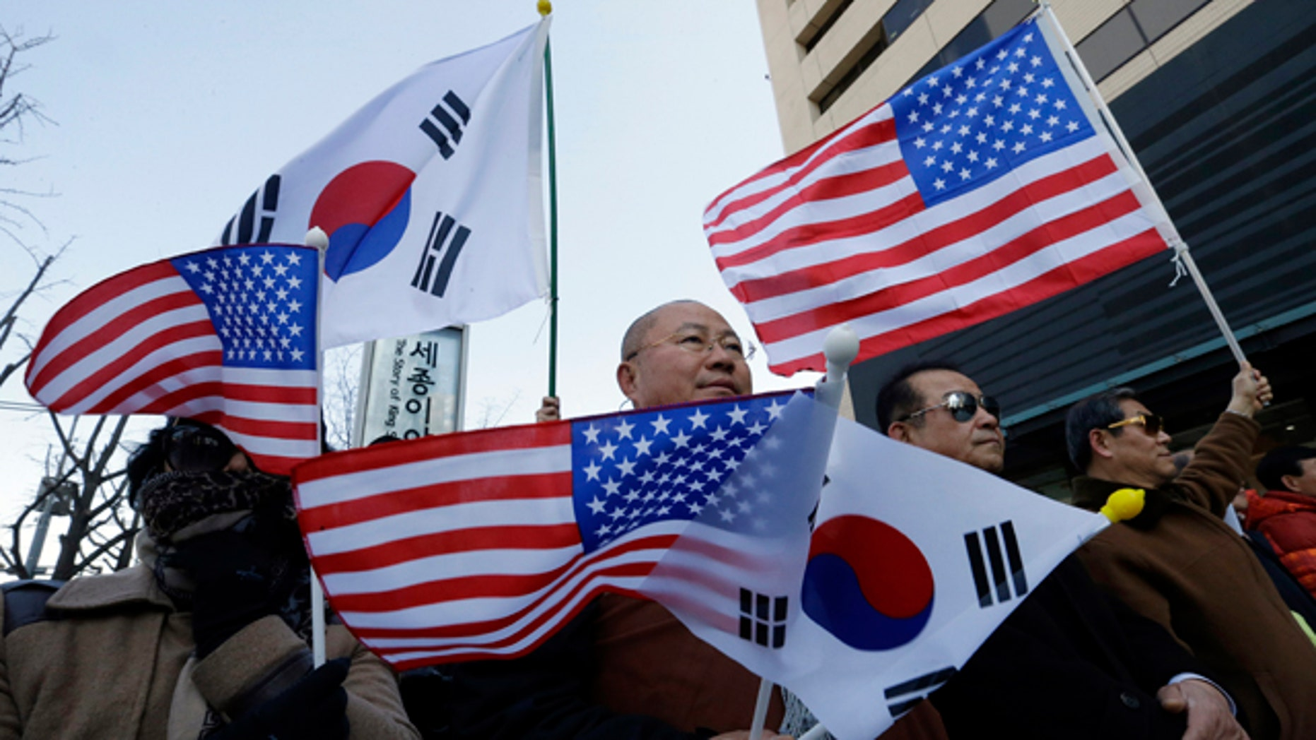March 13, 2015: South Korean conservative activists with the flags of South Korean and the United States stage a rally denouncing the attack on U.S. Ambassador to South Korea Mark Lippert. South Korean police said Friday that an anti-U.S. arrested last week for allegedly stabbing Lippert had intended to kill the envoy to highlight his protest against ongoing U.S.-South Korean military drills. (Ahn Young-joon)