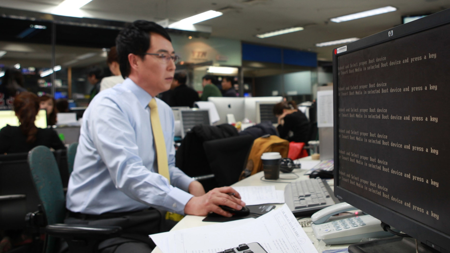 March 20, 2013: An employee works near a computer screen with error message at the newsroom of the all-news cable channel YTN as the broadcaster's computer network was paralyzed in Seoul, South Korea.