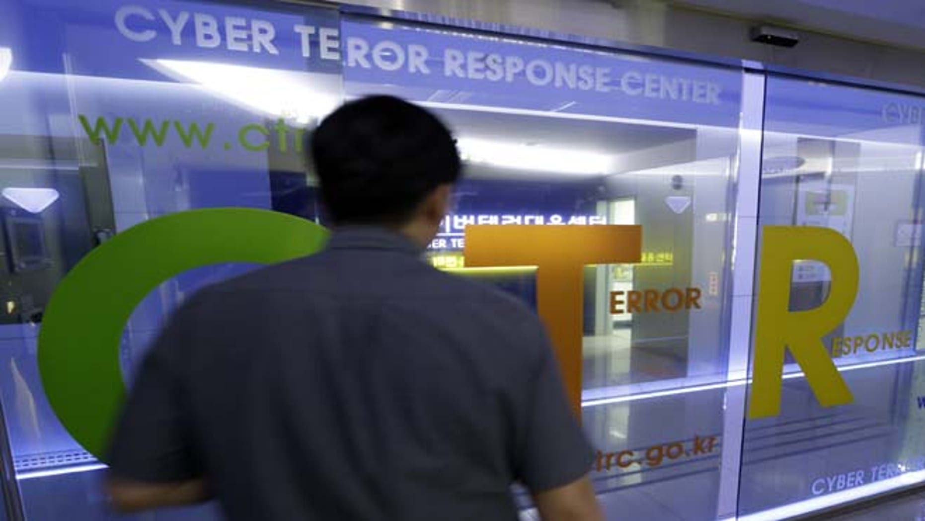 June 25, 2013: A man walks by a gate at Cyber Terror Response Center of National Police Agency in Seoul, South Korea. South Korea said multiple government and private sector websites were hacked on Tuesday's anniversary of the start of the Korean War, and Seoul issued a cyberattack alert warning officials and citizens to take security measures.