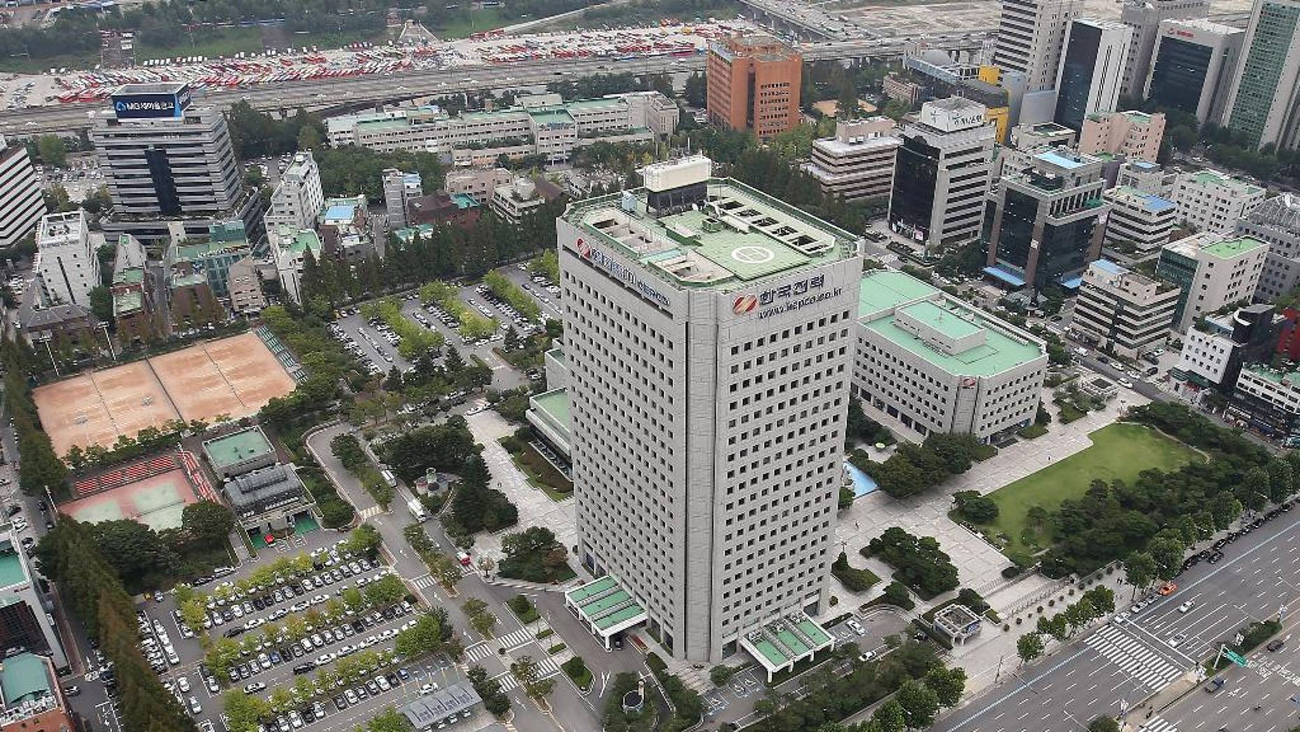 This Sept. 17, 2014 photo, shows Korea Electric Power Corp's headquarters, center, in Seoul, South Korea. The consortium led by Hyundai Motor Co. offered 10.55 trillion won ($10.1 billion) for land in Seoul's tony Gangnam district where it will build a new headquarters, on Thursday, Sept. 18, 2014. (AP Photo/Yonhap, Han Jong-chan) KOREA OUT