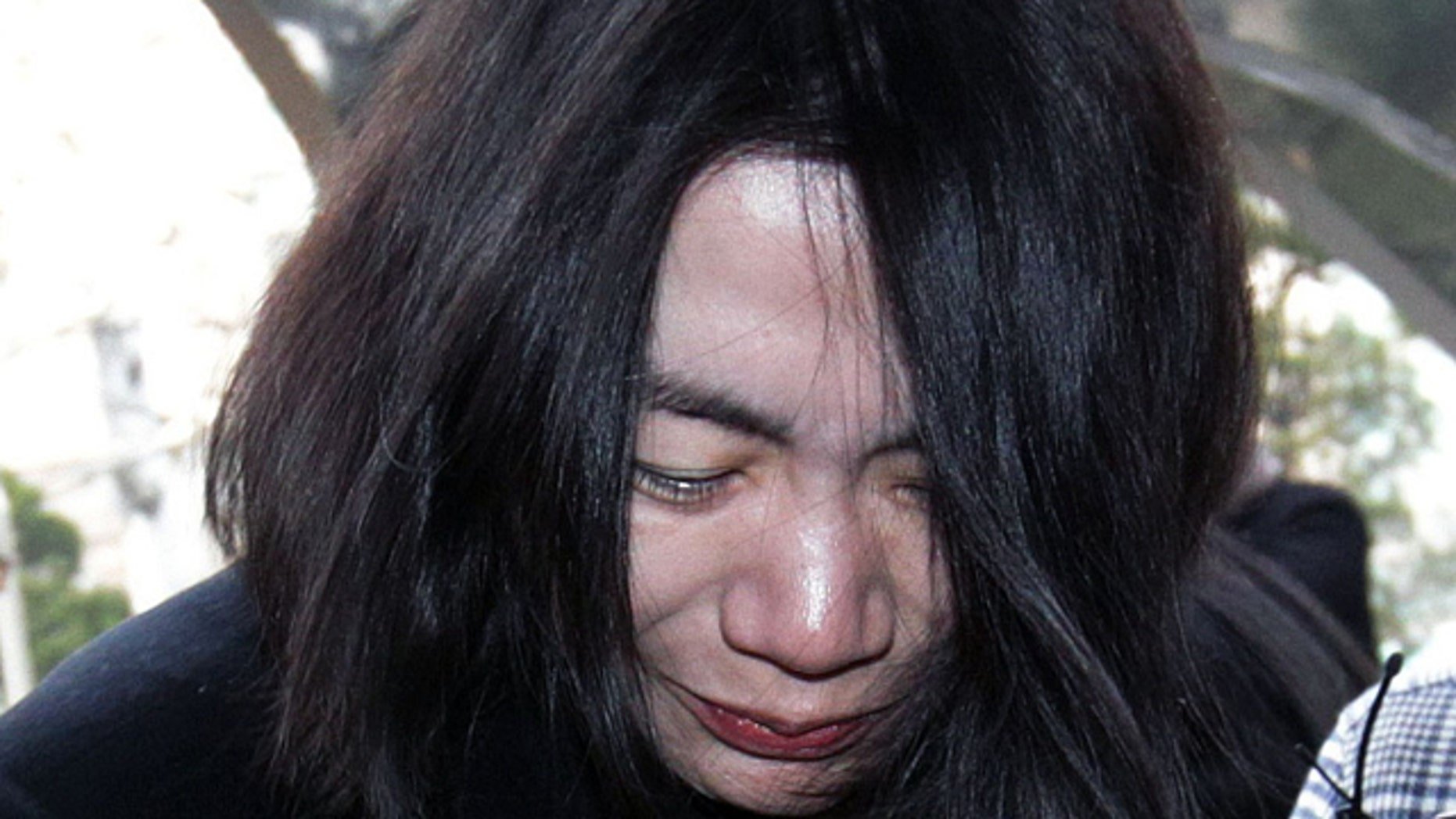 Dec. 30, 2014: Cho Hyun-ah, former vice president of Korean Air Lines, arrives at the Seoul Western District Prosecutors Office. A court found Cho guilty of violating aviation safety law after a trial that stemmed from her tantrum over how she was served macadamia nuts on a flight. (AP Photo/Ahn Young-joon, File)