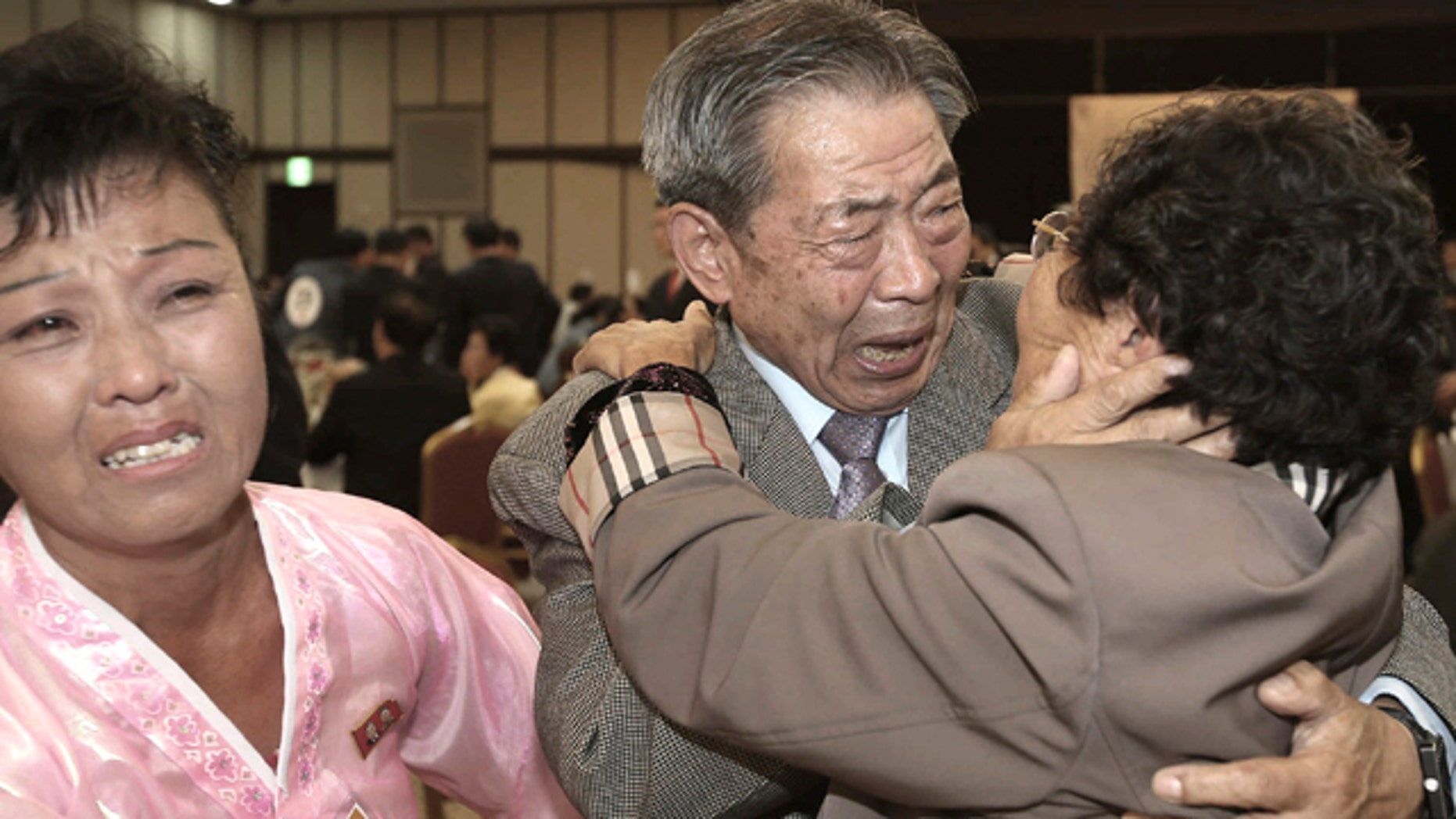 Oct. 20, 2015: South Korean Min Ho-shik, 84, center, hugs his North Korean family member Min Un Sik, right, during the Separated Family Reunion Meeting at Diamond Mountain resort in North Korea. (Kim Do-hoon/Yonhap via AP)