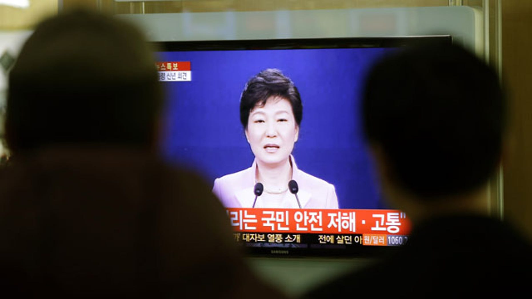 January 6, 2014: People watch a television program airing South Korean President Park Geun-hye's New Year's speech to the nation, at the Seoul Train Station. Park called on Monday for resuming reunions of families separated by war, saying it was a chance to improve strained ties between the rival Koreas. (AP Photo/Lee Jin-man)
